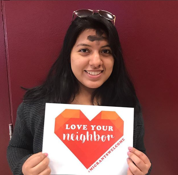 A student at Santa Clara University participates in the Love Your Neighbor Campaign.
