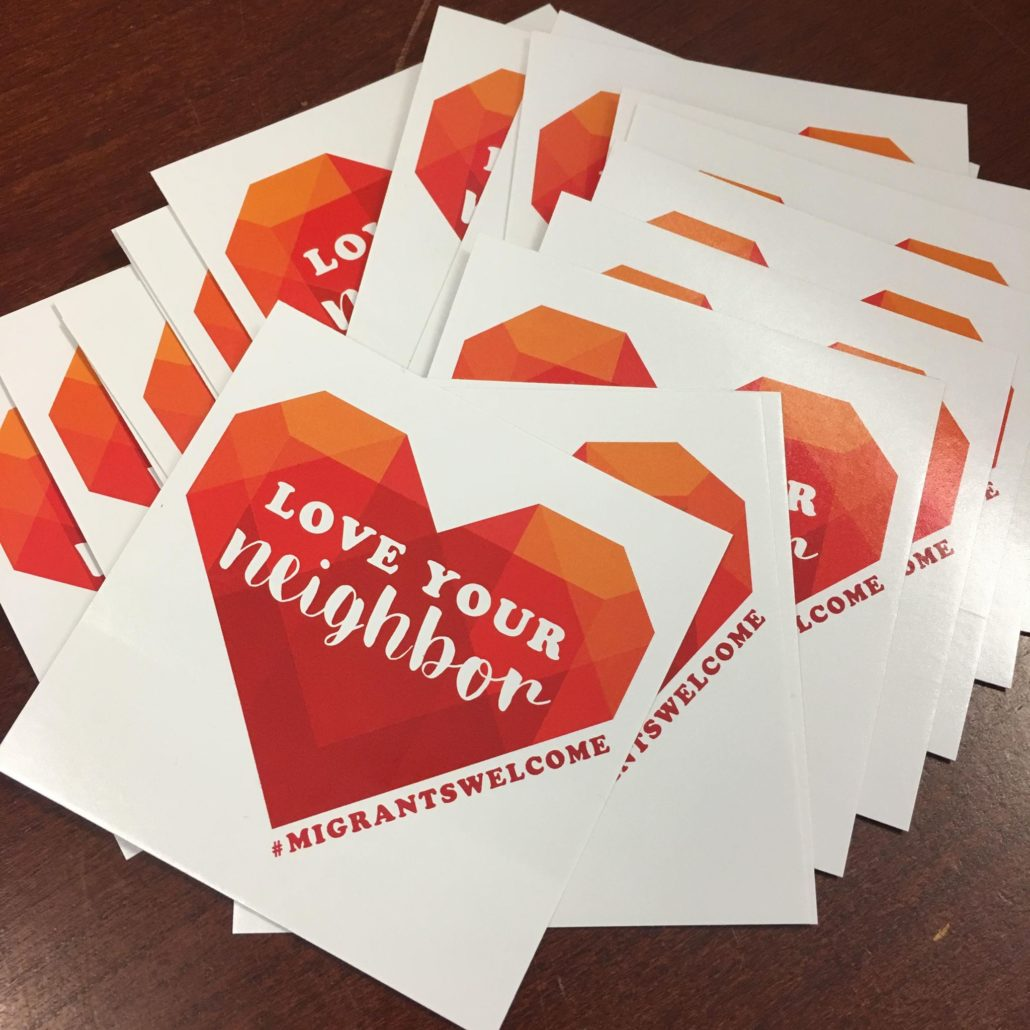 Love Your Neighbor campaign stickers.