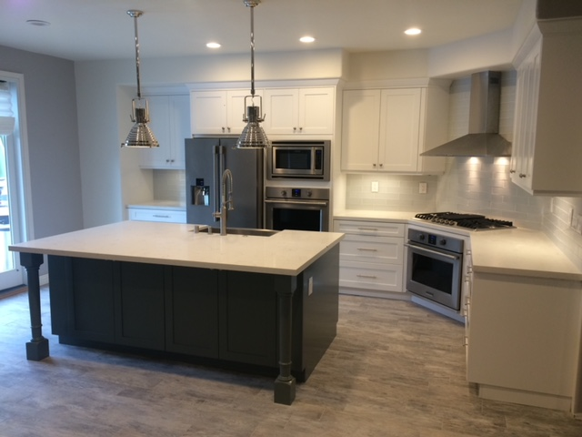 Kitchen remodel around Santa Clarita, CA. Complete upgrade: cabinets, appliances, countertops, flooring and painting.