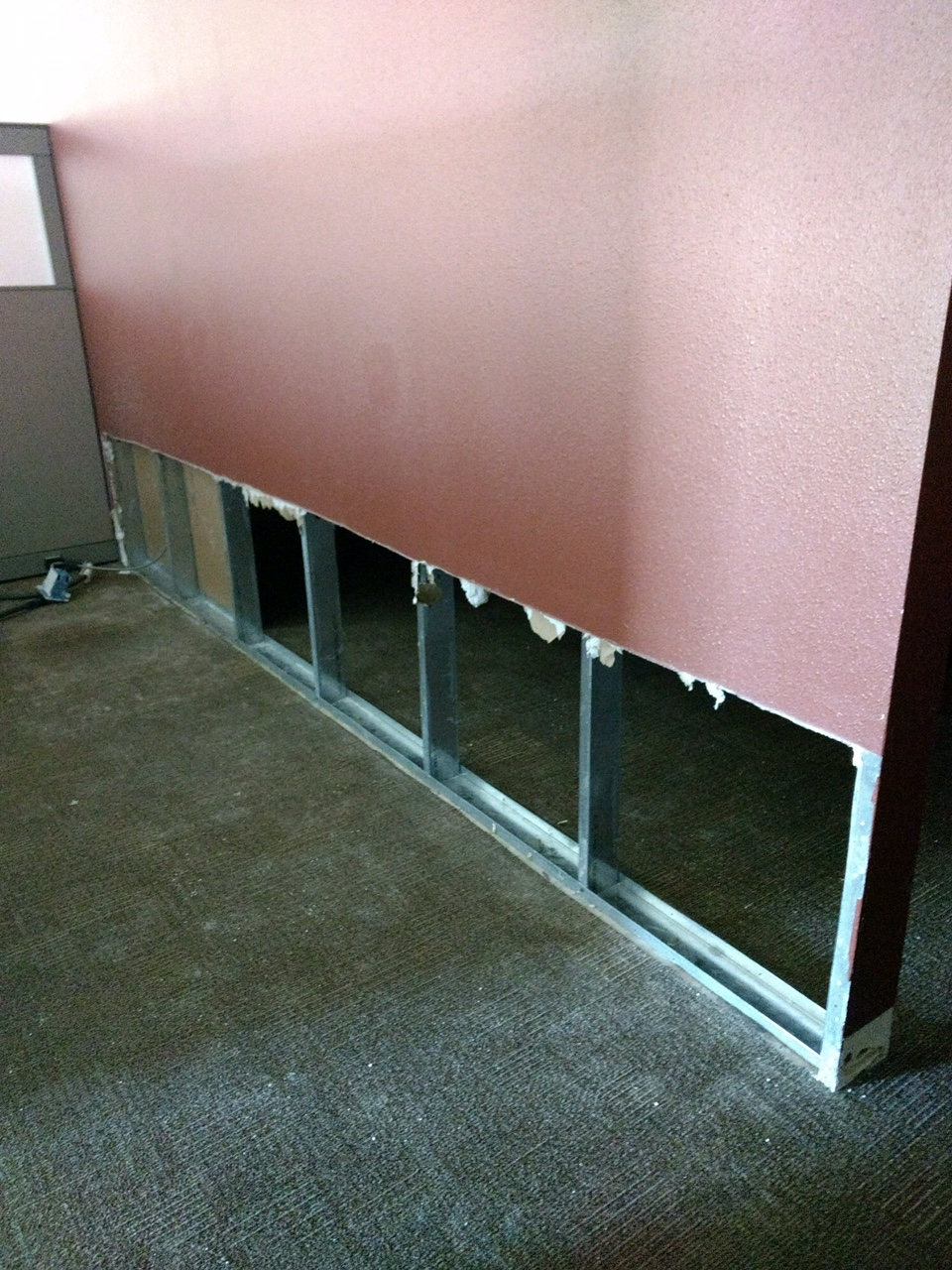 Drywall project at store in Burbank, CA. Demolition down to metal studs to upgrade drywall finish to level 5. Some framing. Carpet and flooring upgrade.
