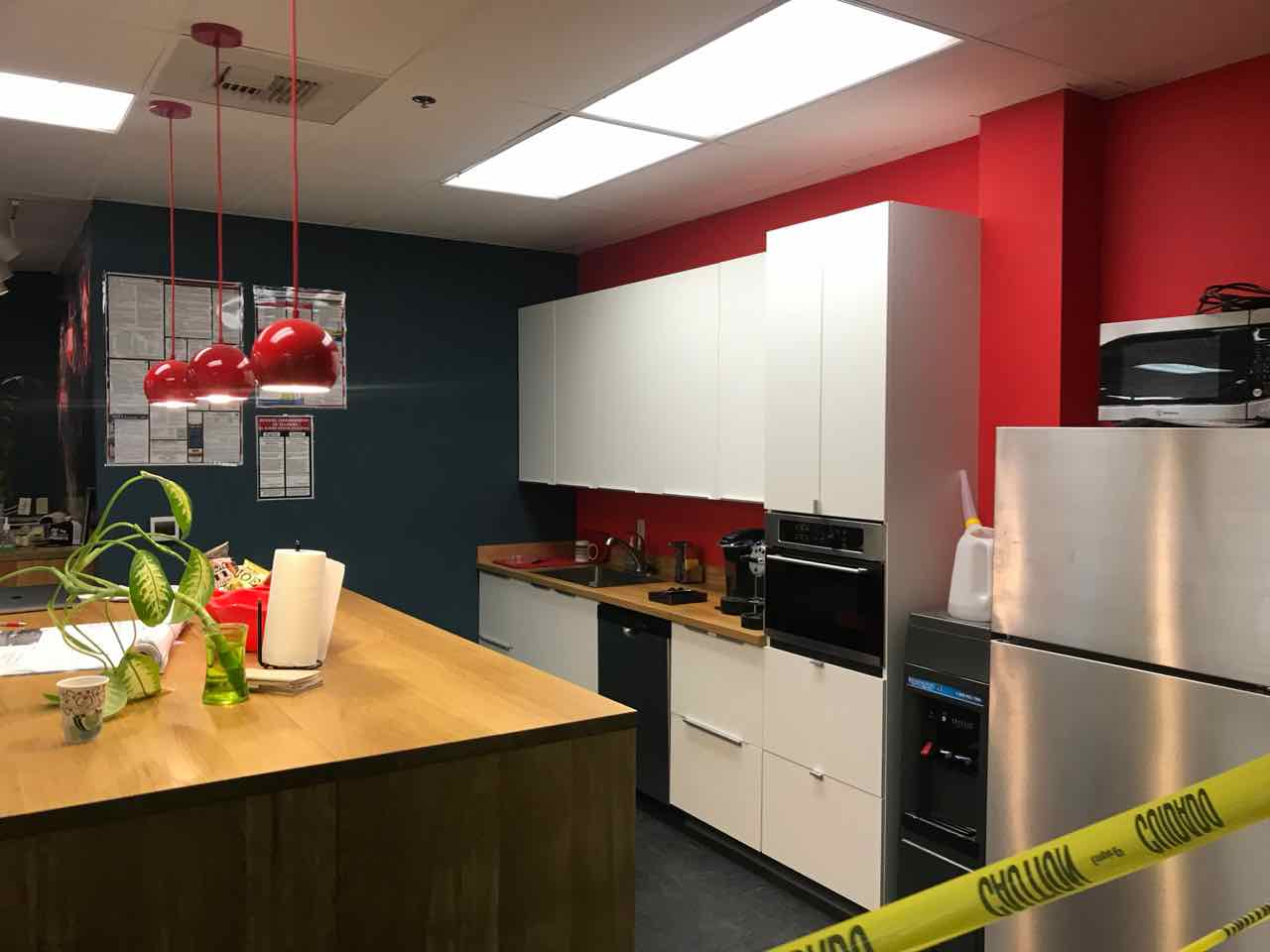 Commercial kitchen inside office suite for 50 employees. Complete remodel and upgrade, including cabinets, plumbing, custom island, painting and flooring.