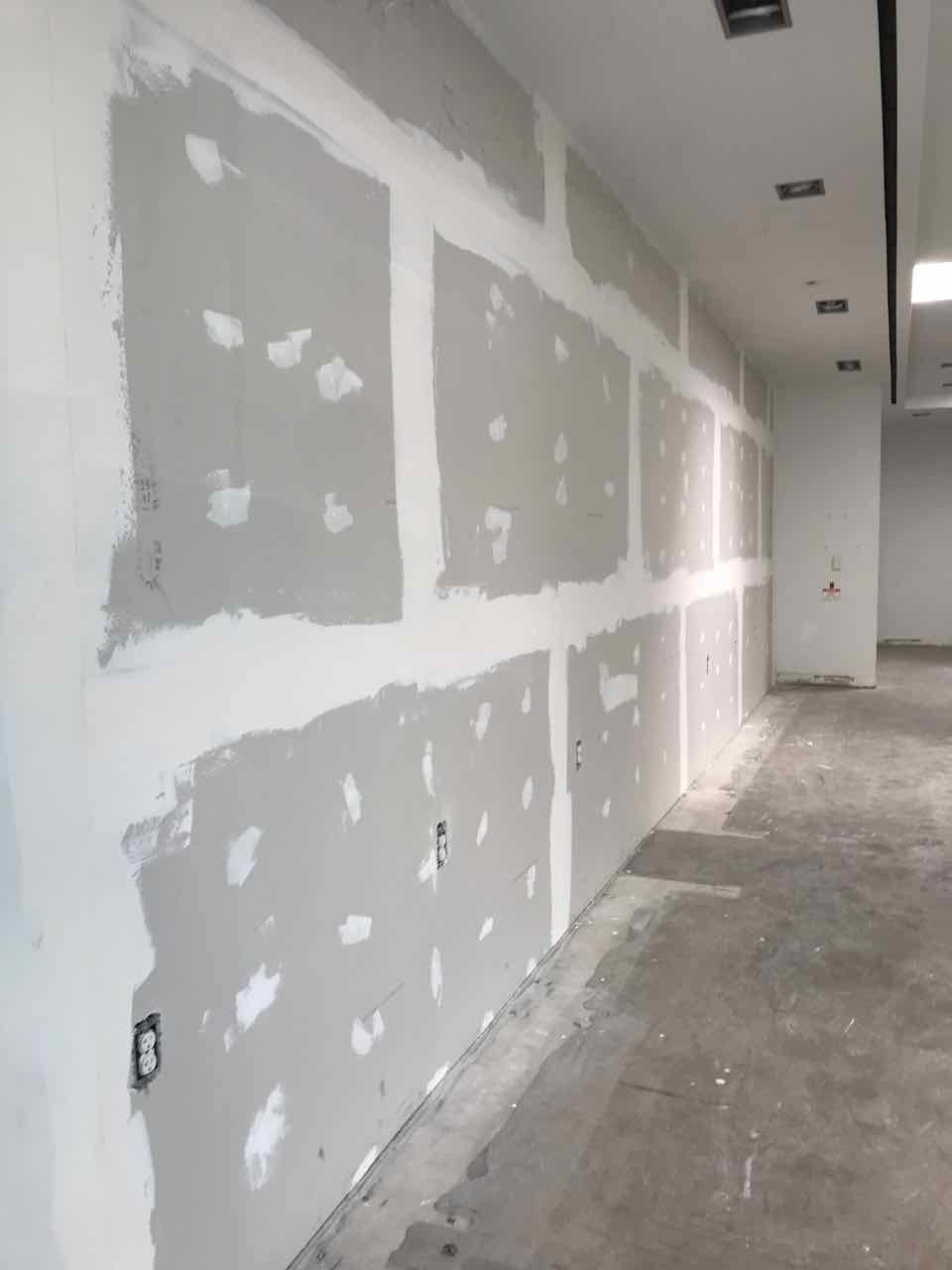 Framing, drywall, taping, texturing and painting for office suite inside commercial building. Raw concrete upgraded to polished concrete as finished flooring.