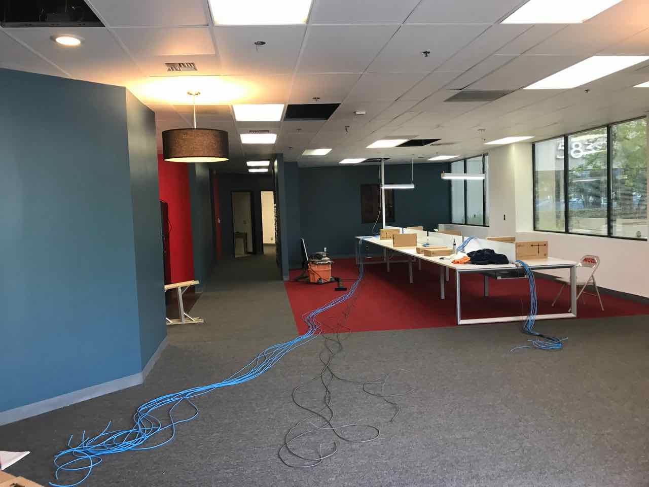 Office remodel in Los Angeles, CA. Major tenant improvement: demolition, walls, electrical, acoustic ceiling (t-bar and ceiling tiles), carpet, painting, and floor plan redesign.