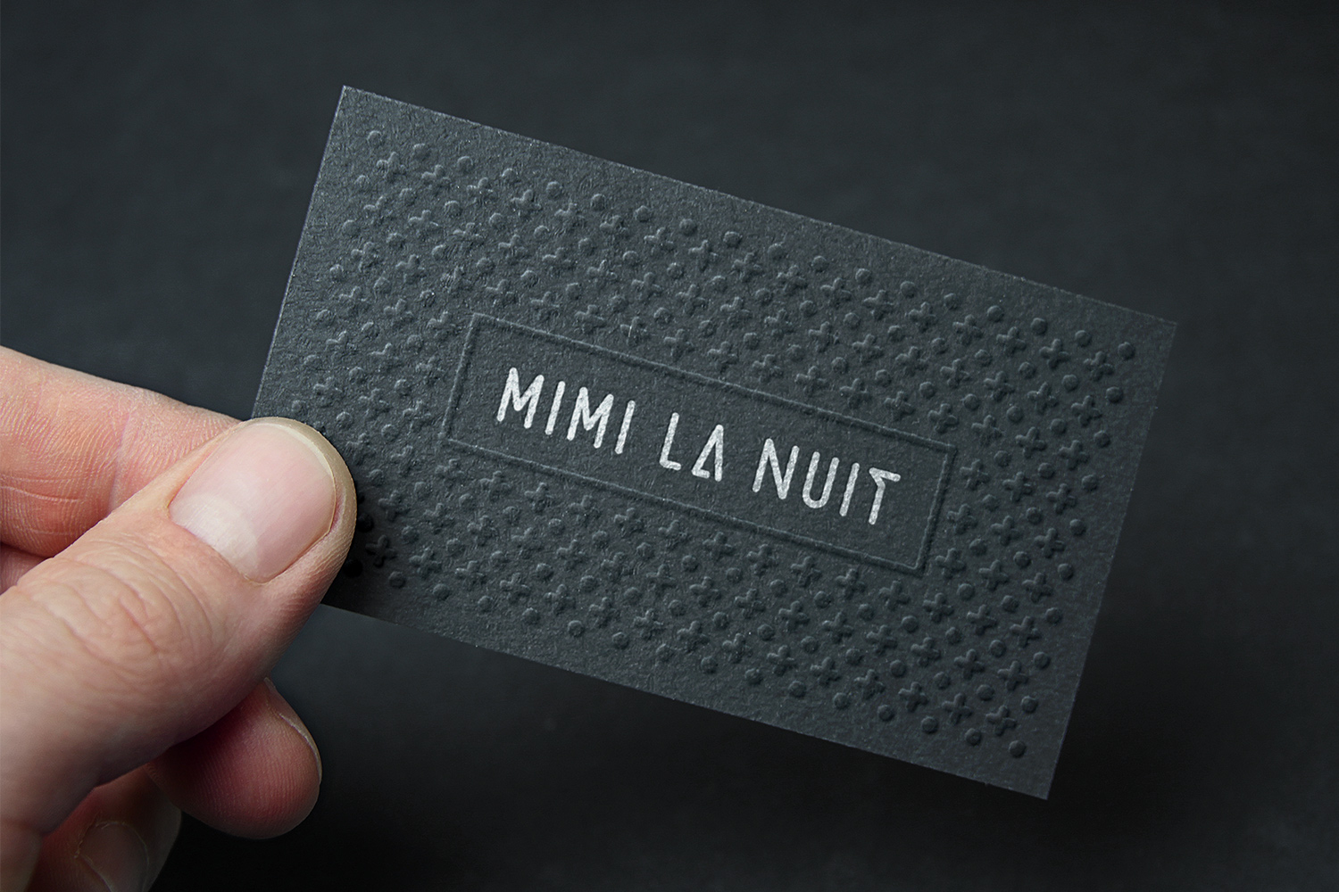 Restaurant business card. Embossed cardboard with minimalist and modern pattern made of a composition of dots and crosses. Silver text, centered inside a rectangle. Built-in Branding 360