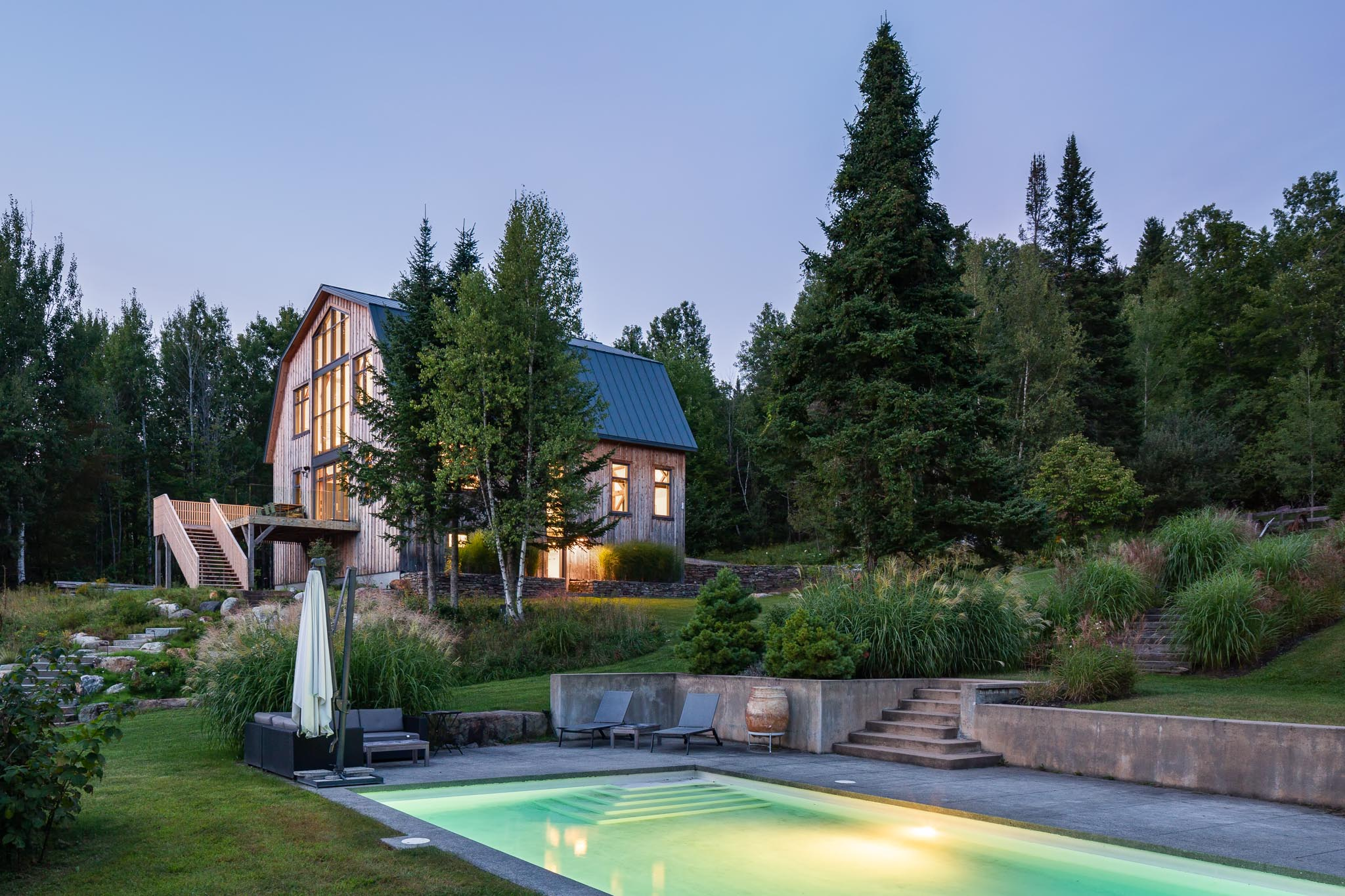 Renovation of a cottage and landscaping. Modern concrete pool. Exterior coating of the barn in boards of cedar board and batten. Large windows and cedar rear terrace