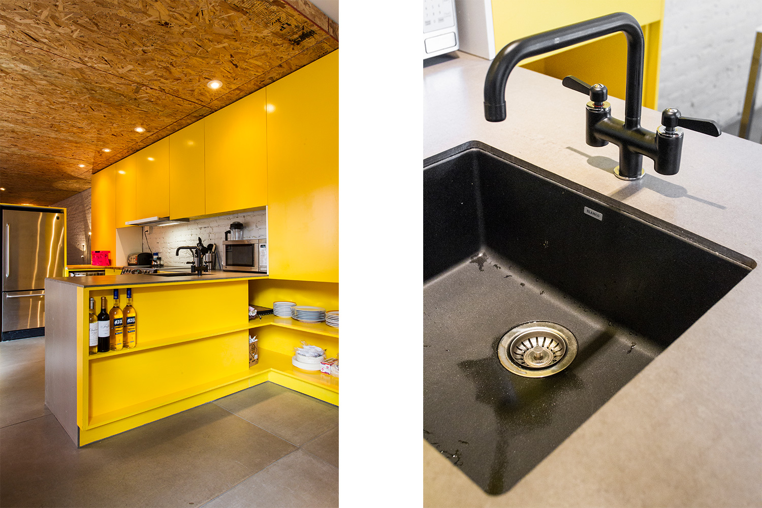 White painted brick wall. Yellow custom kitchen. Concrete floor. Ceiling finished with osb panels. Counter made of fiber cement panels. Sink in black silgranit.