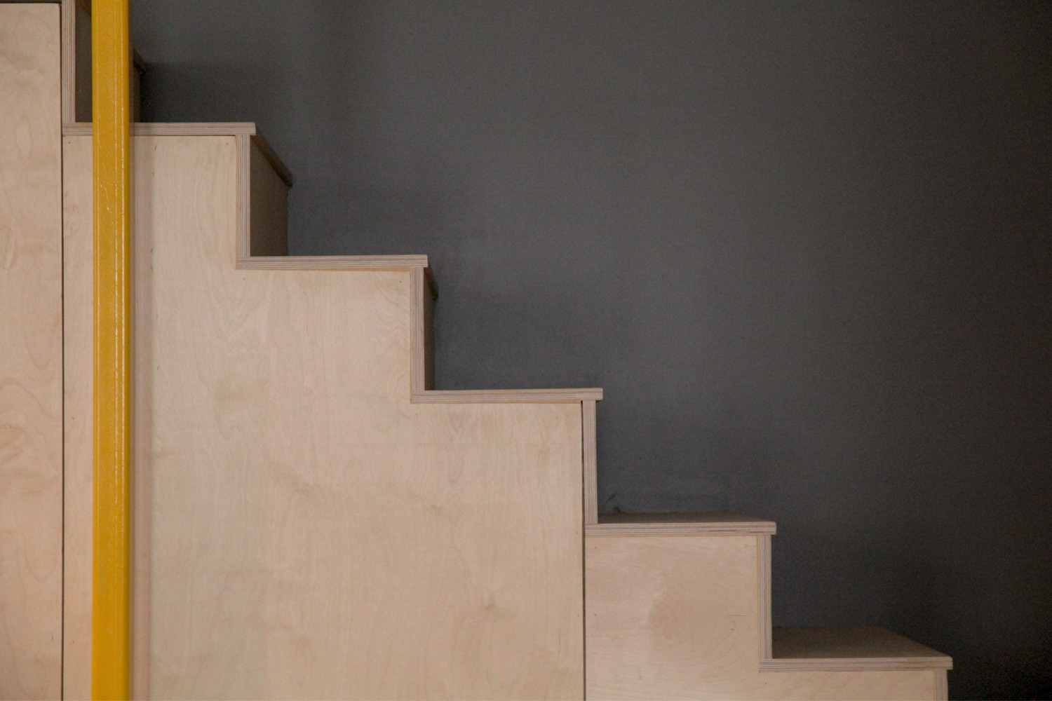 Staircase made of plywood. Structure holding the floor tubular square steel 4x4 yellow.