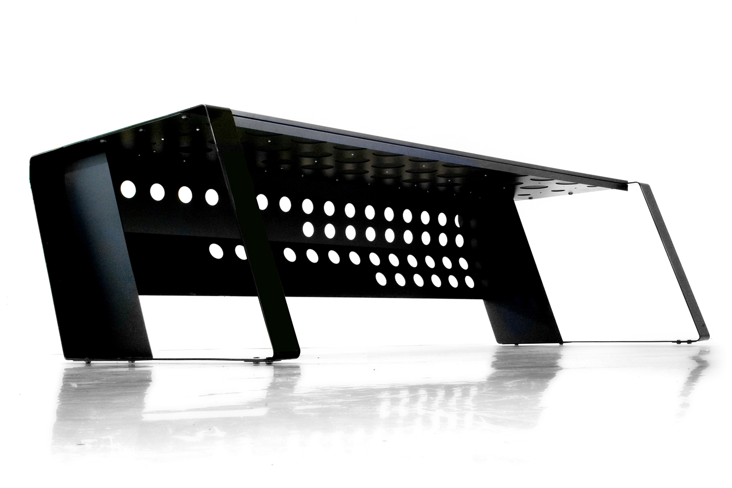 Custom made office folded metal finished black powder coat. Laser perforated shutter panel for sliding cables.