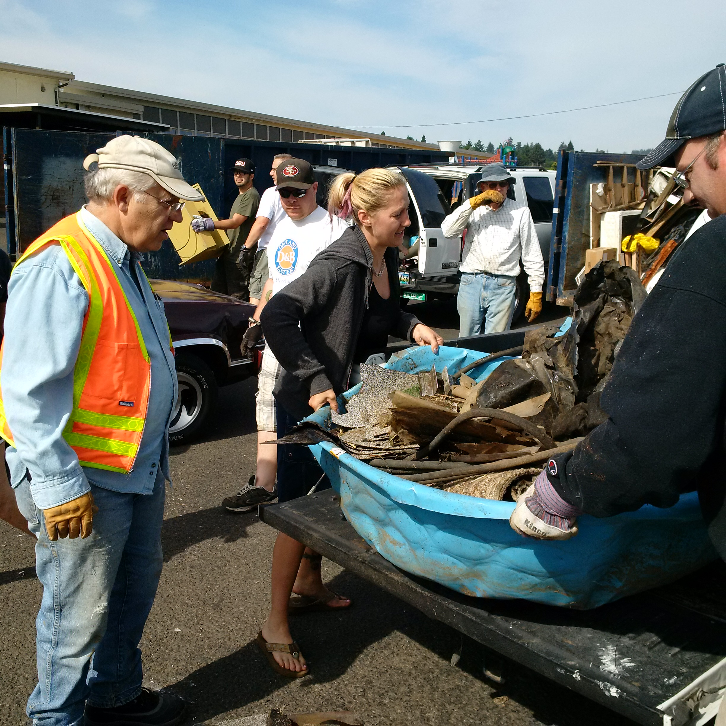 Moving debris at the 2014 Neighborhood Clean Up. Photo by: Mid County Memo