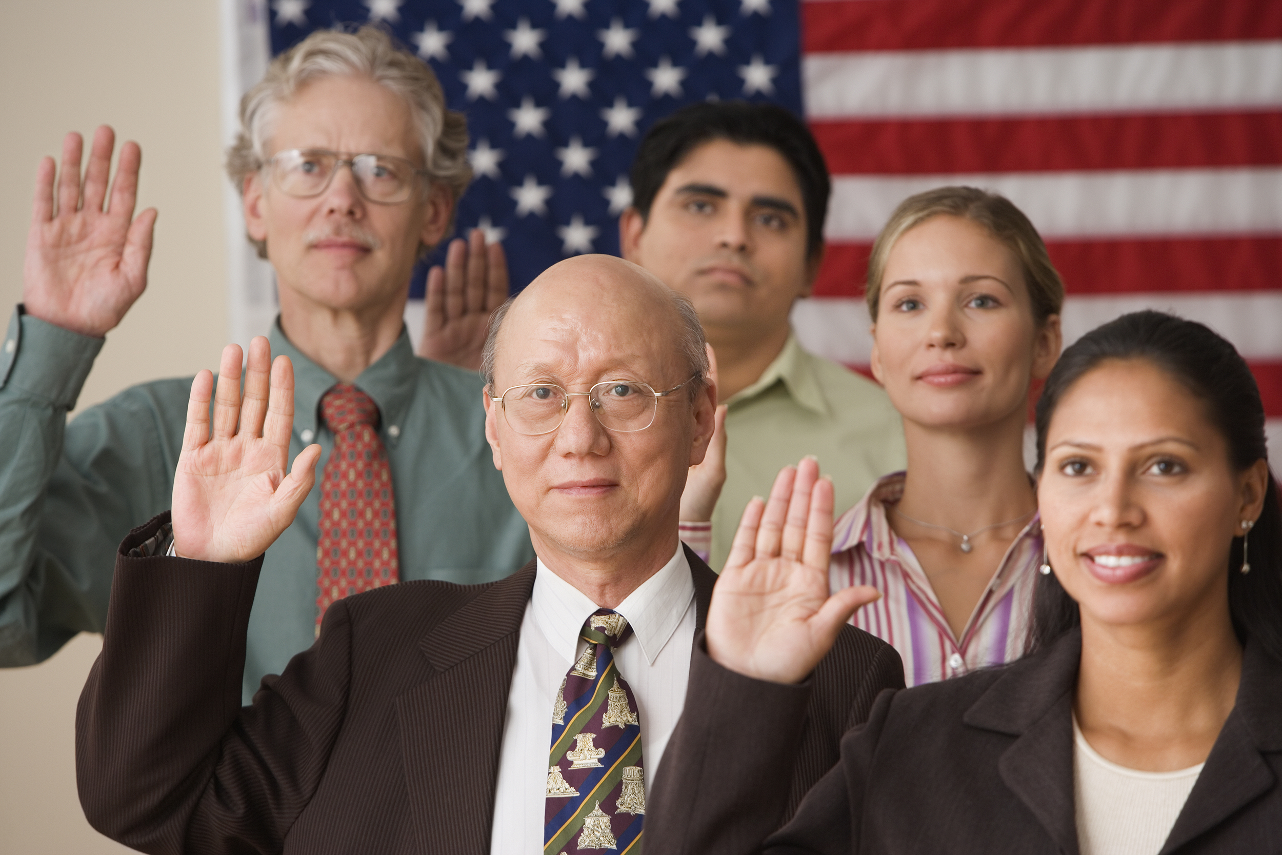Immigrants swearing in as US Citizens. Bethel offers class.
