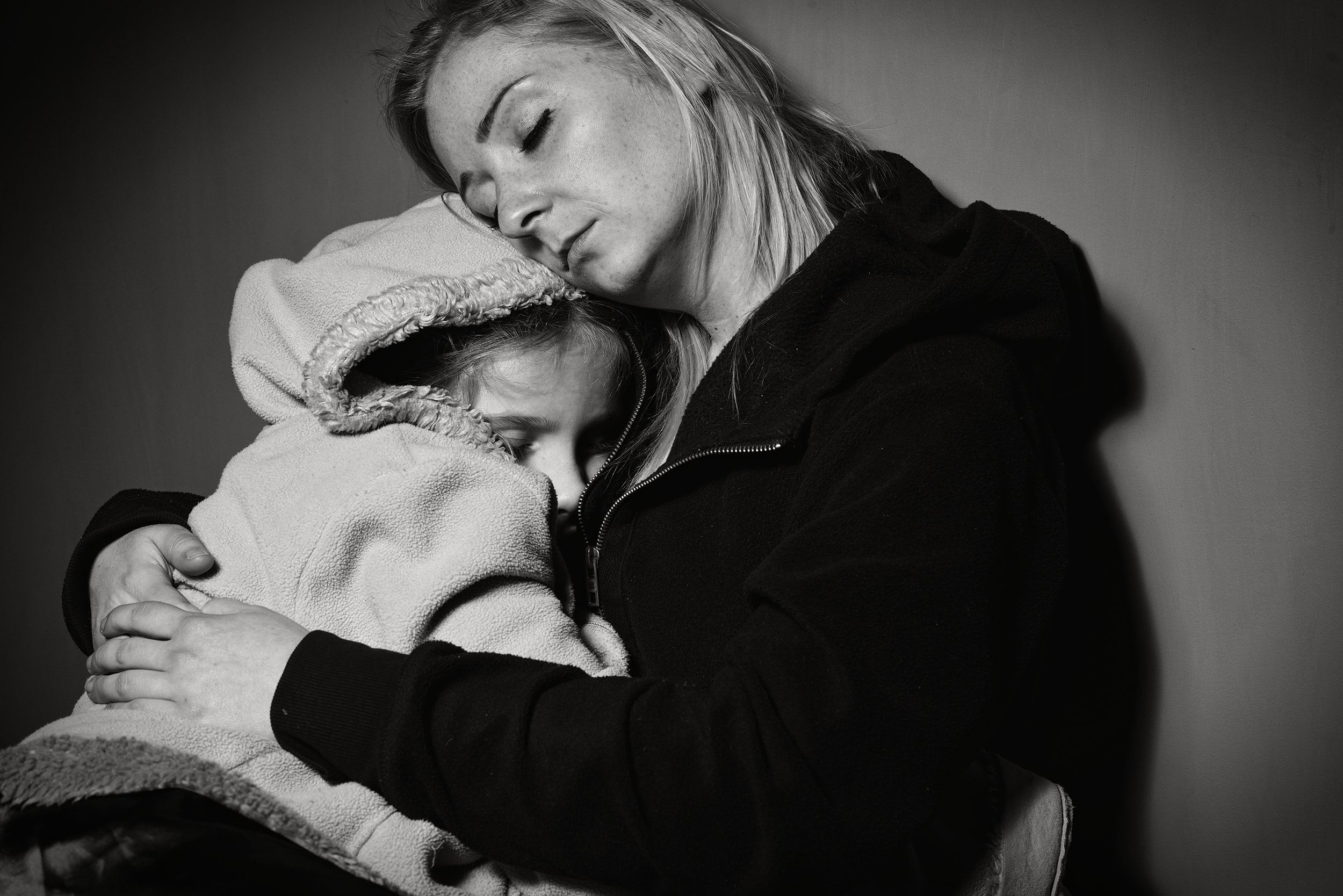 Mother embracing daughter, possible beneficiaries of Habitat for Humanity