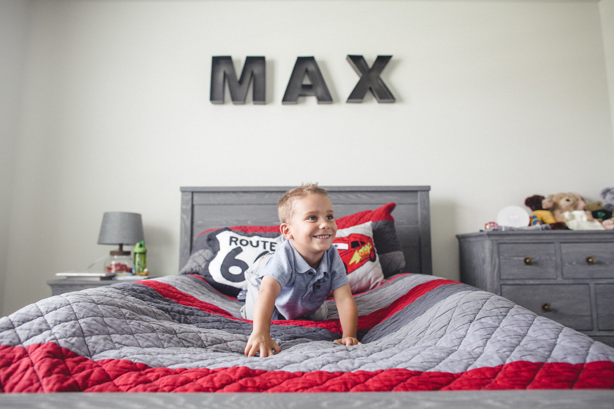 Boy in bedroom - Rochester MI in-home child photographer