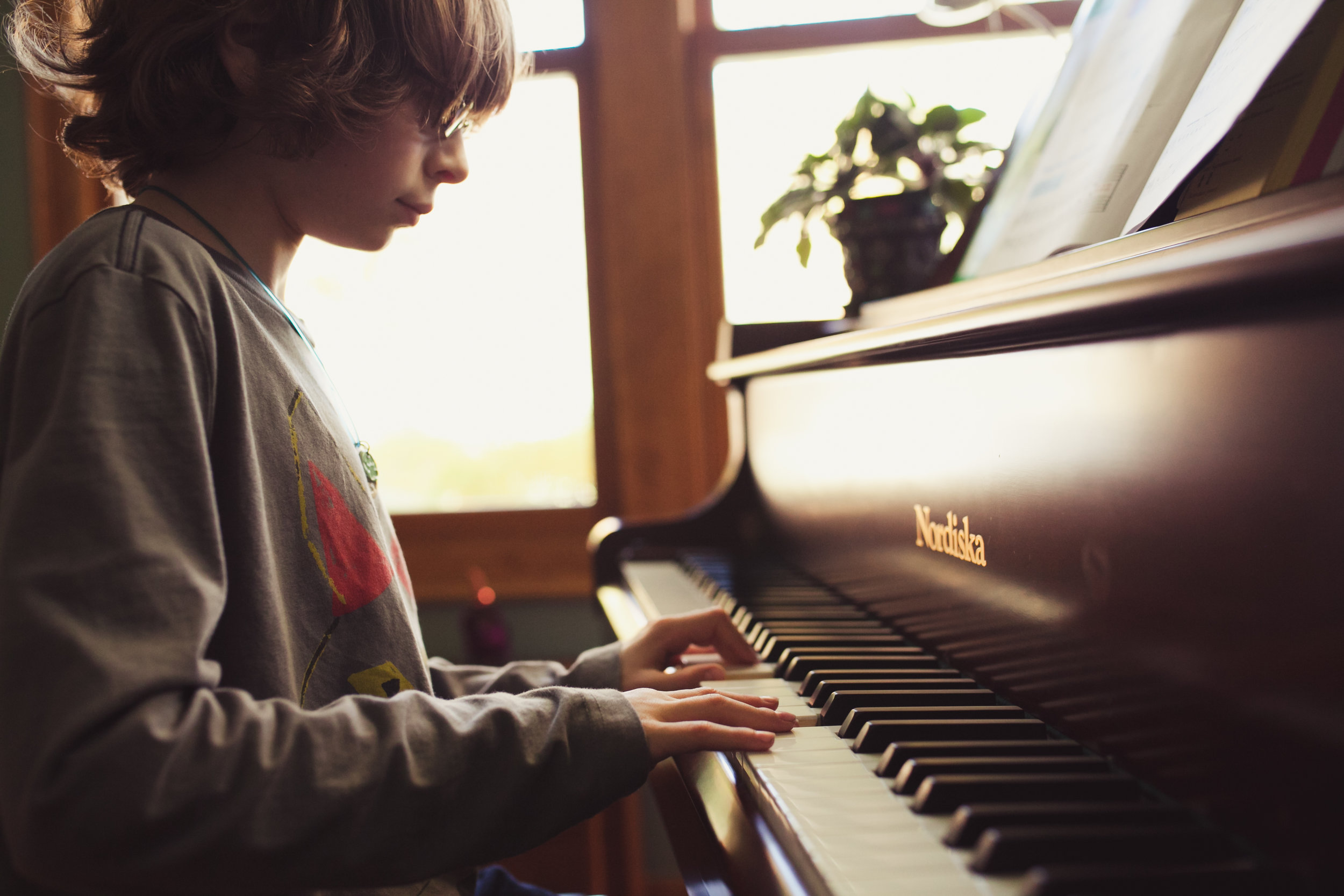 boy playing piano - metro detroit lifestyle child photographer
