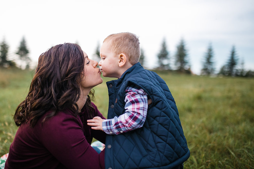 Mommy and son candid photograph kissing