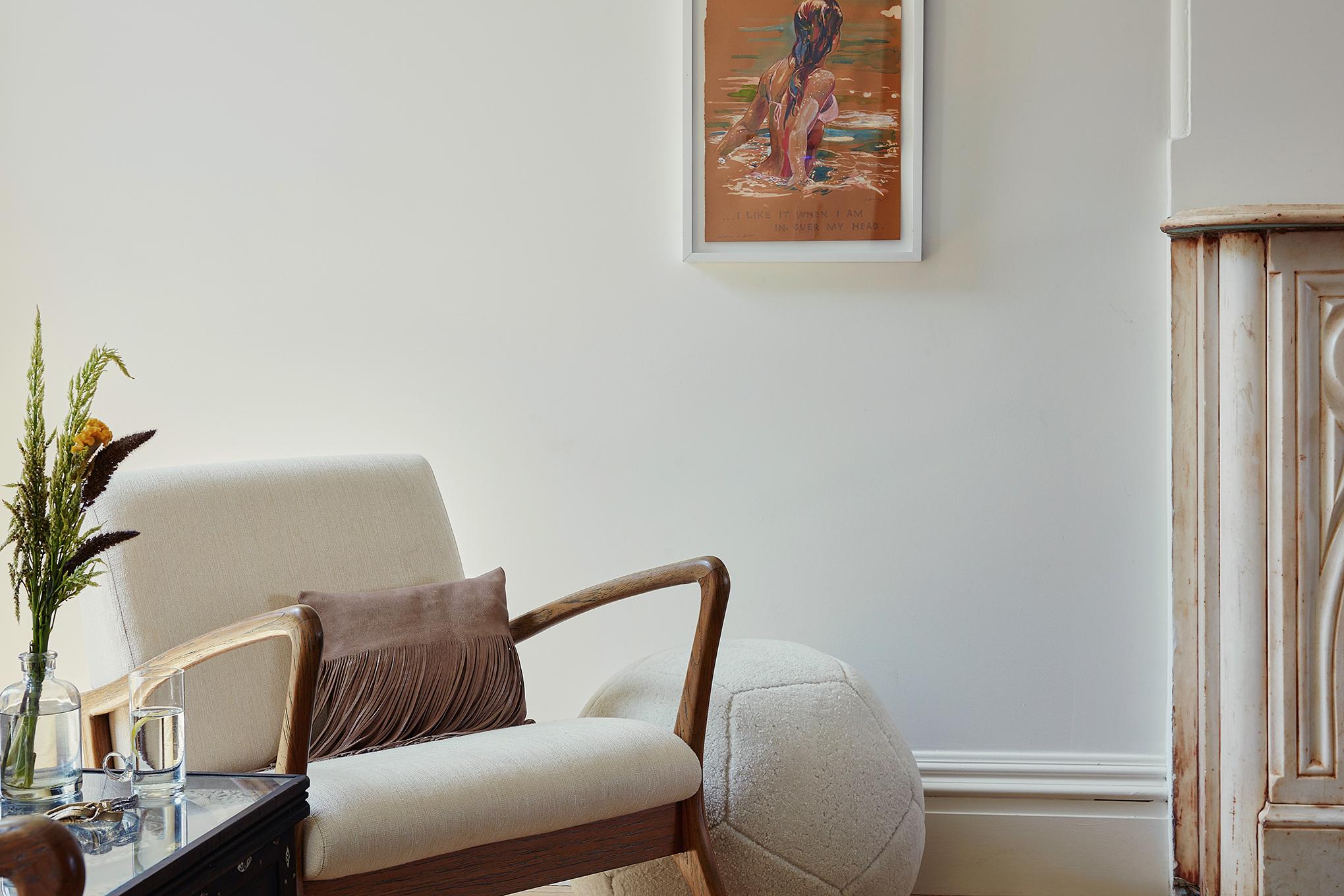 King Ottoman X  in Cream Sheepskin, and  Fringe Pillow  in Taupe Leather : Nicole Watts Studio - Park Slope Townhouse | Photo: Josephine Rozman