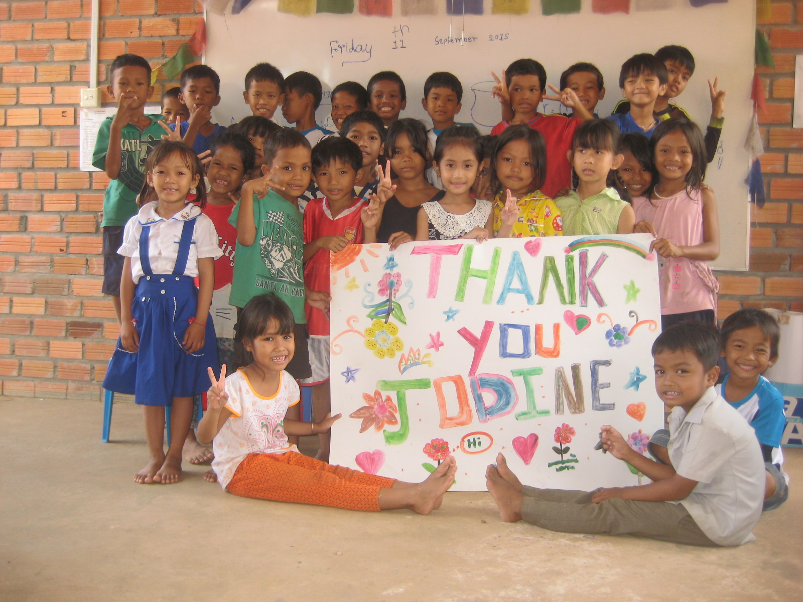 Jodiine received this poster from the kids she helped to educated and feed.