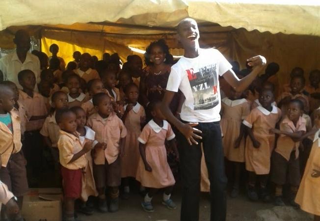 George inspiring a group of school kids