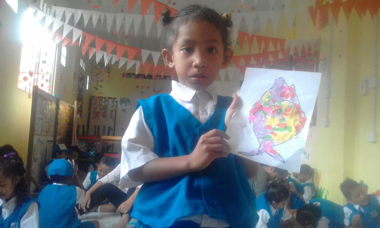 A student showing her work in their previous classroom