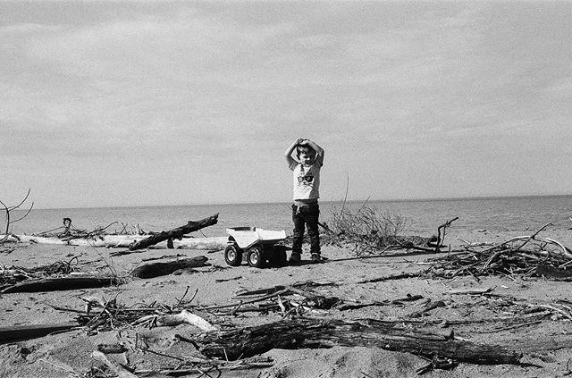 Parenting Tip: take your kids and some toys to the very edge of the earth and take post apocalyptic black and white film photos of them. They'll sleep the whole way home. #ilfordhp5pushed800 #bigtonka