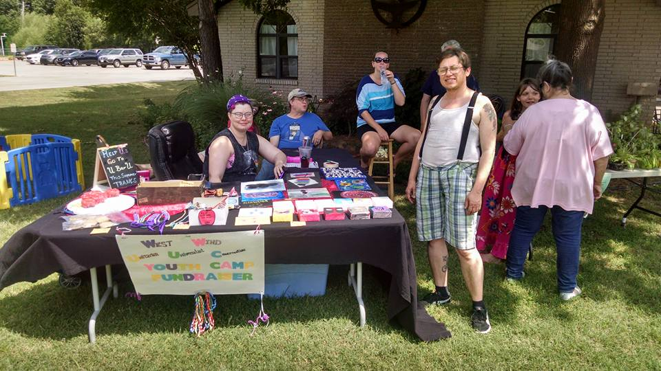 Raising money for Summer camp by selling art and baked good at the Yard Sale