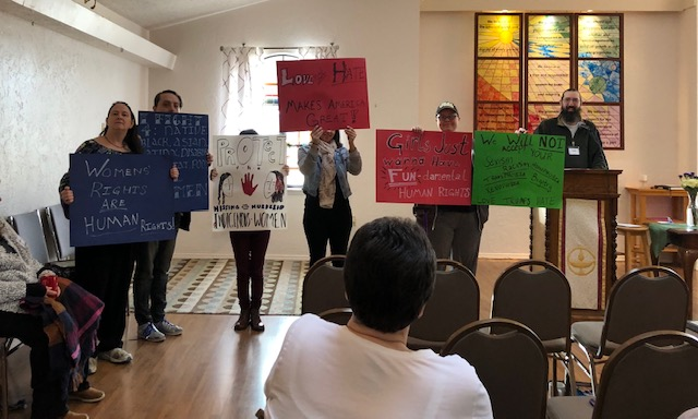 2019 Women's March - WWUUC Teens display signs they made for theOKC Women's March 2019