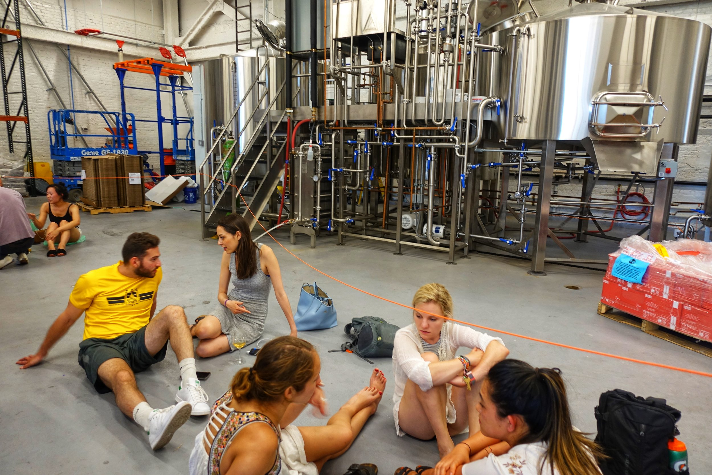 People spread out on the floor near the brewhouse at Grimm