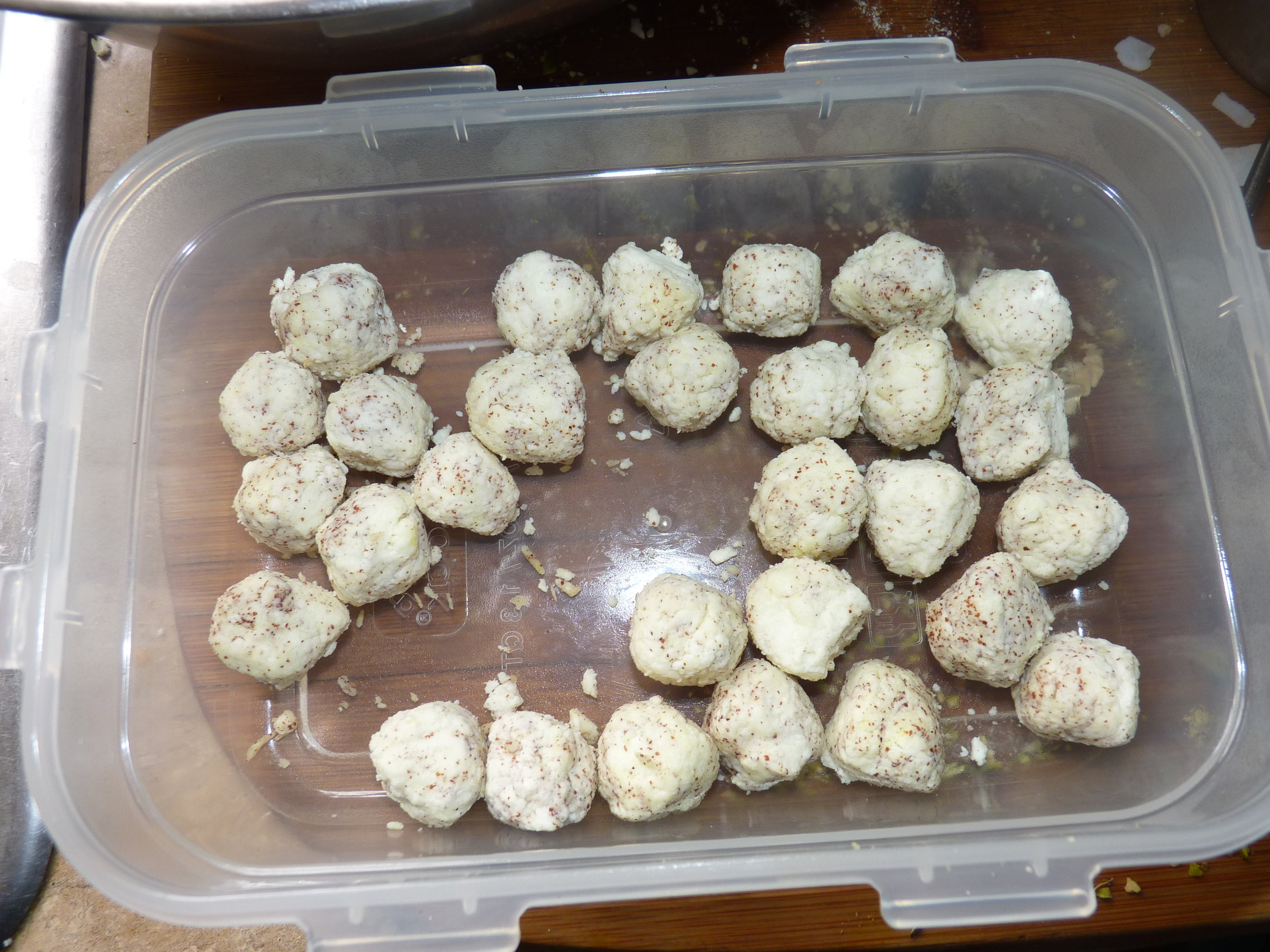 Roll the chenna cheese into balls with ragi (or rice flour) as a binder