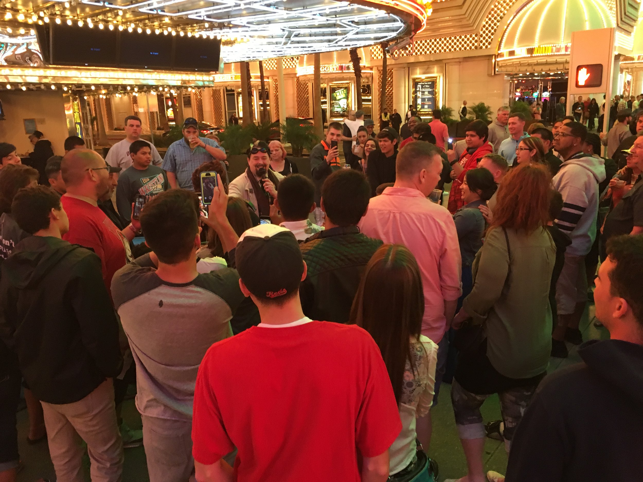 I've gathered quite a crowd of people here in front of the 4 Queens Hotel and Casino on Fremont Street.