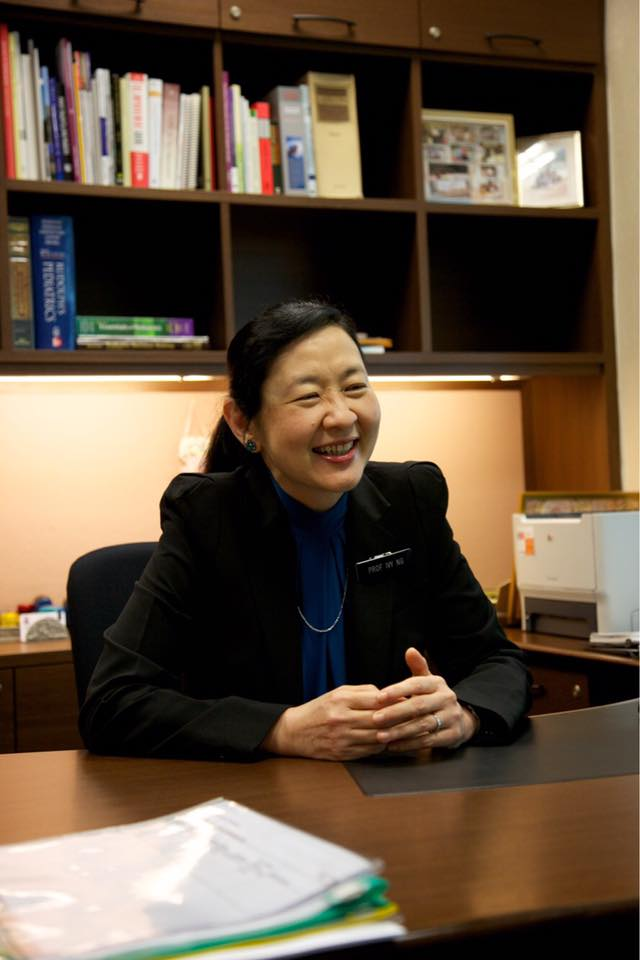 """Professor Ivy Ng served as CEO of KKH from 2004-2012 and was responsible for establishing the hospital as a regional leader in obstetrics, gynaecology, paediatrics and neonatology. She was appointed the Deputy Group CEO of SingHealth from 2008 to 2012 and assumed the role of SingHealth Group CEO in January 2012. A paediatric geneticist by training, Prof Ng is also an adjunct professor at Duke-NUS Medical School Singapore and a clinical professor at NUS.   Why did you choose to specialise in paediatrics and genetics?  """"Let's take a step back to why I wanted to do Medicine. My dad used to tell me, """"You only have one life, use it to help other people"""". That's why I did Medicine. When I first started, it didn't seem so clear which speciality to go for. I found myself enjoying paediatrics the most and decided when I was a house officer. During my housemanship, I did postings at paediatrics and orthopaedics etc and I totally enjoyed the paediatric posting because it was such a happy ward. Of course, the difficult part was doing procedures on kids. That was difficult more because the baby would be crying, the parents would be crying, the grandparents would be upset.  I would advise medical students to choose what they enjoy most and what they're most passionate about. If you are in your 1st and 2nd year, you don't have to worry yet – focus on passing your exams!   How was studying medicine like in the past?  """"We had real cadavers and did our own dissection. We studied on this campus (SGH); the lecture theatres were in the College of Medicine building and behind that was the anatomy building. There used to be a canteen called Ah Leng's and a football field at the area where Duke-NUS is. It was really good fun. In the past, the paediatrics department was at Mistri Wing, which is the building right next to the Bowyer Block where the medical wards were located. Mistri Wing used to house two paediatric wards for sick children and later NHCS, and it is now home to the Diabetes a"""