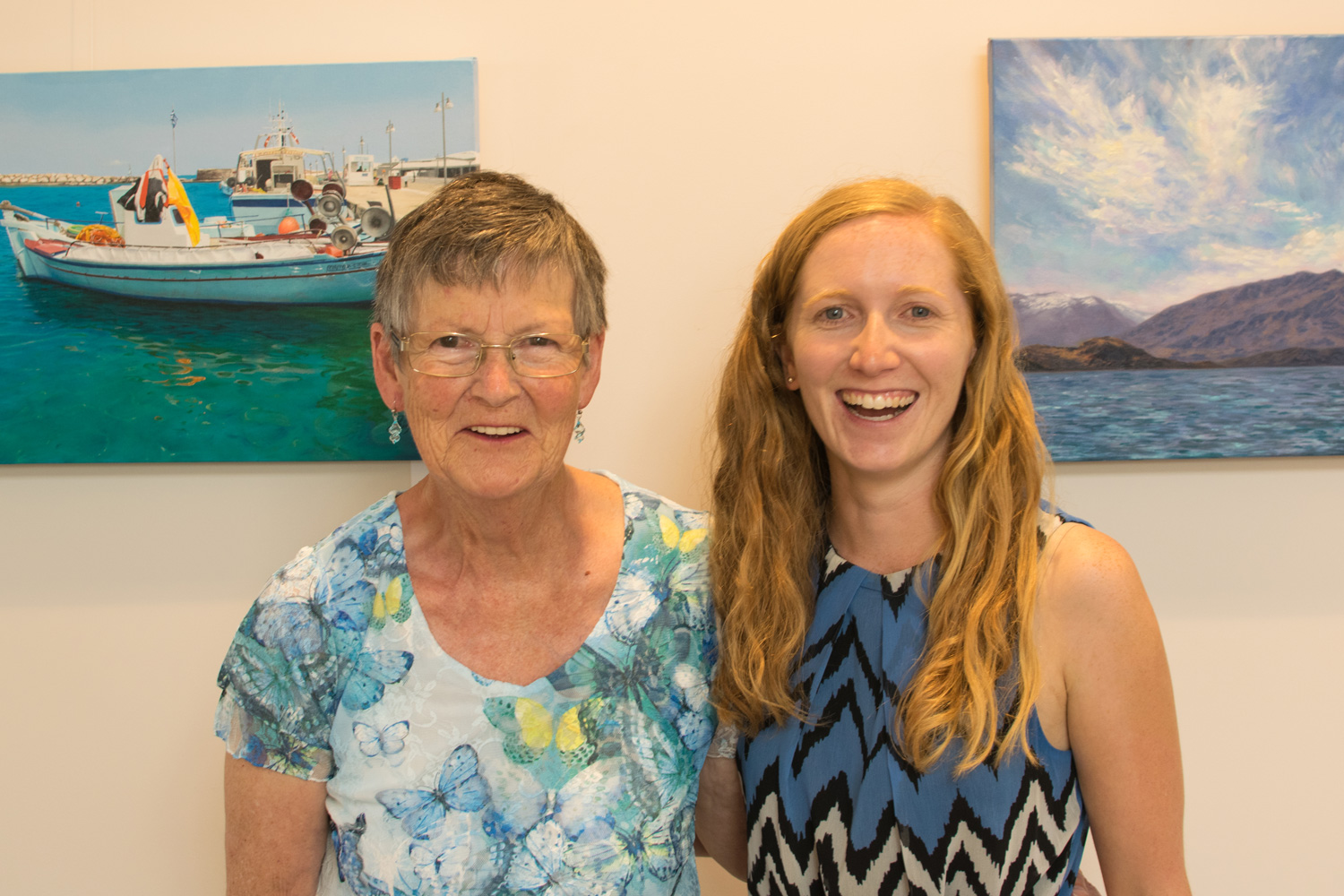 Lorraine and I colour matching with the paintings behind us.