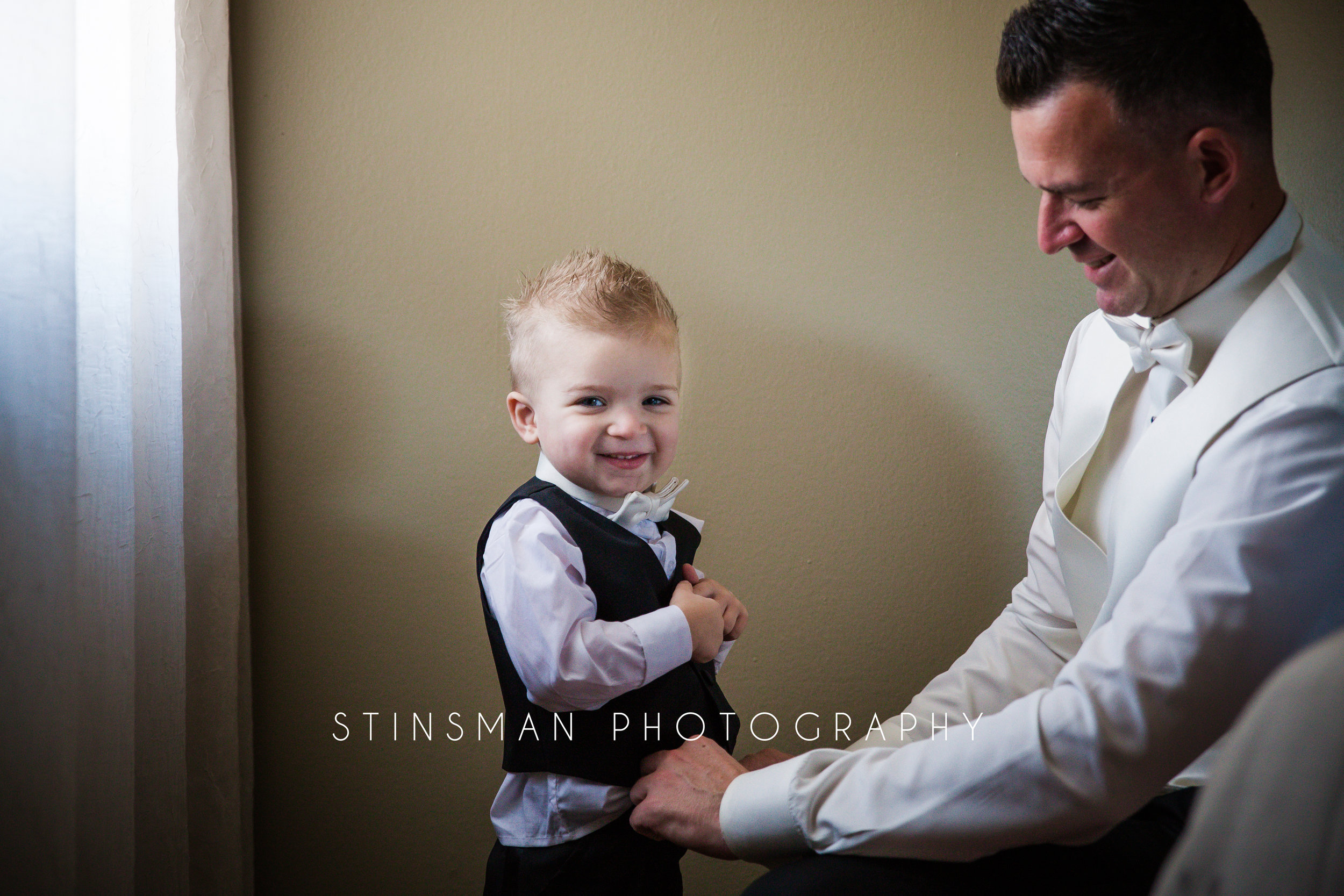 grooms son getting ready for wedding photos