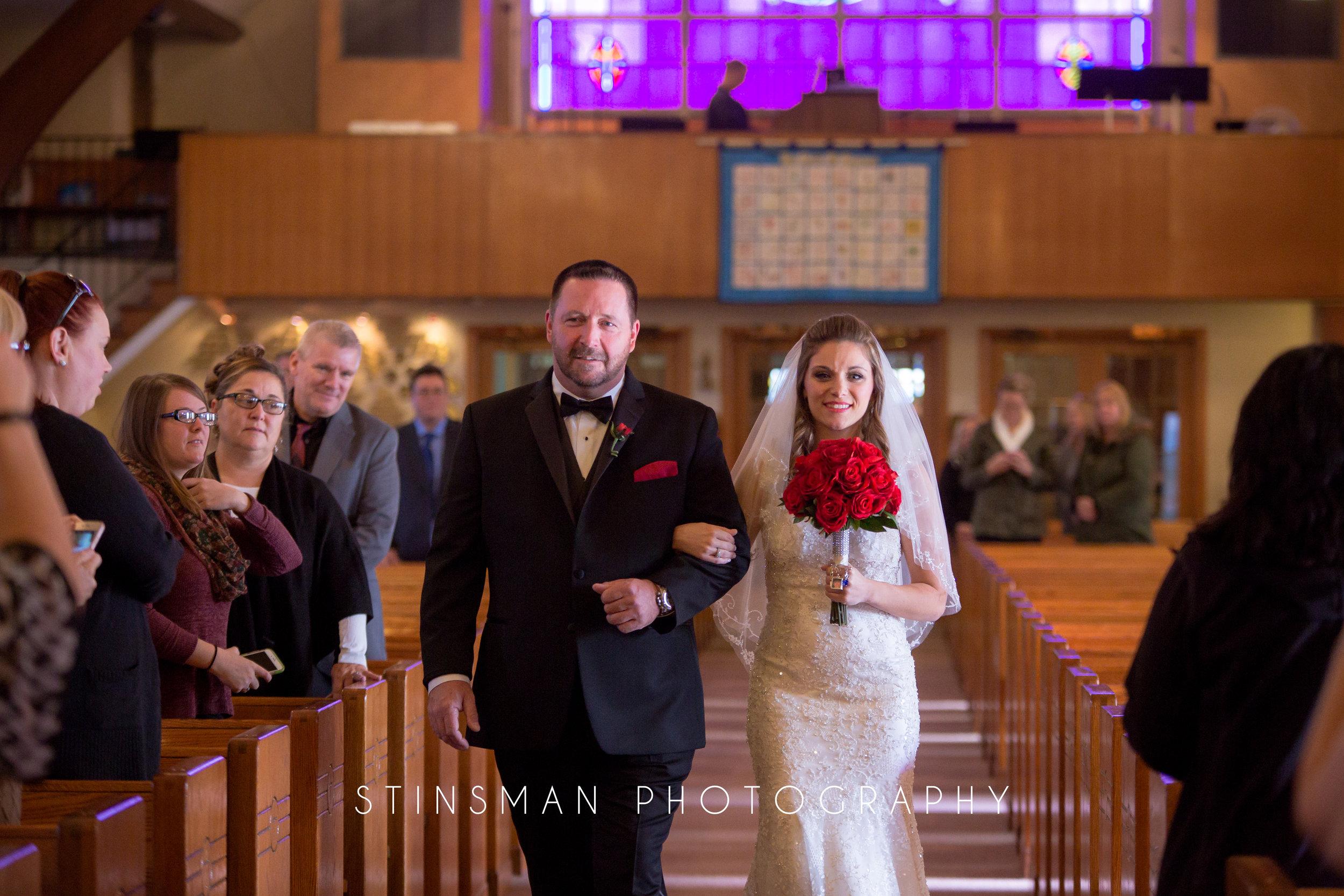 bride walking down the aisle at the church