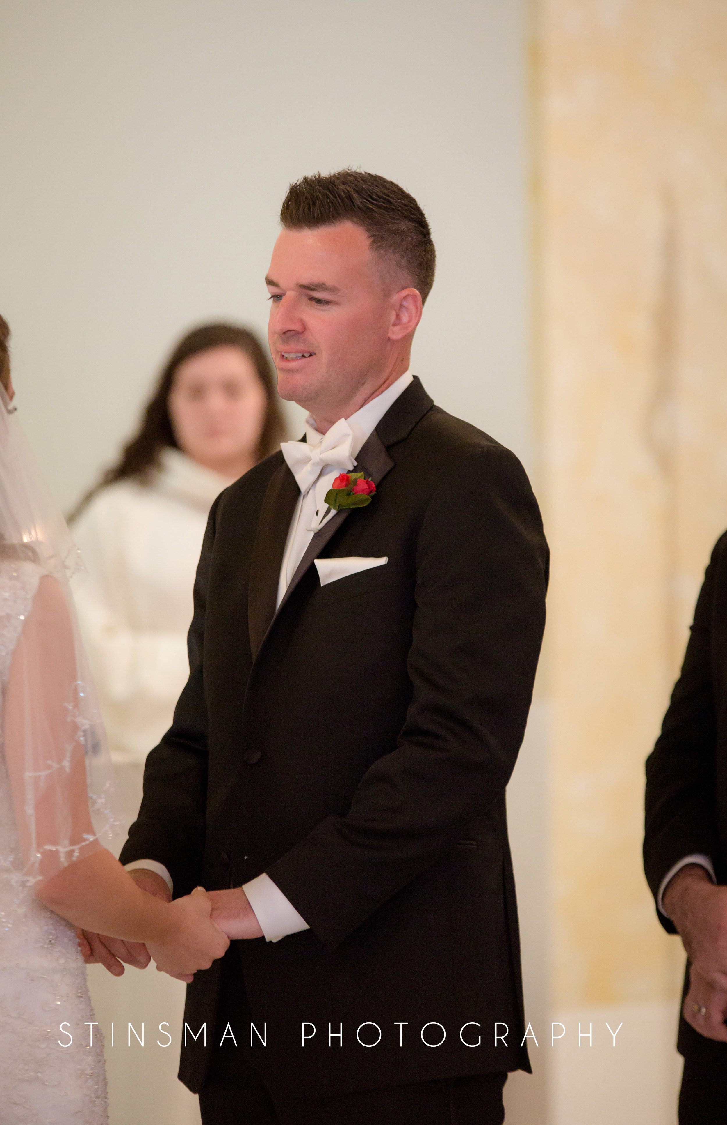 groom stating his vows to his bride