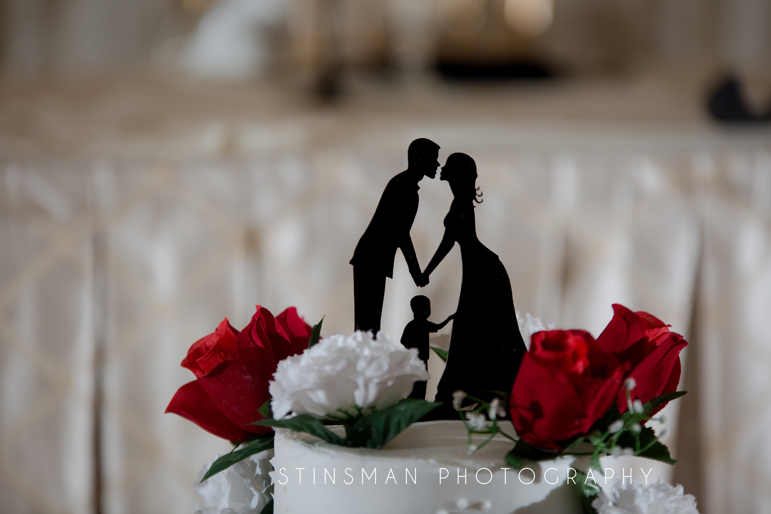 cake topper with a child in the middle