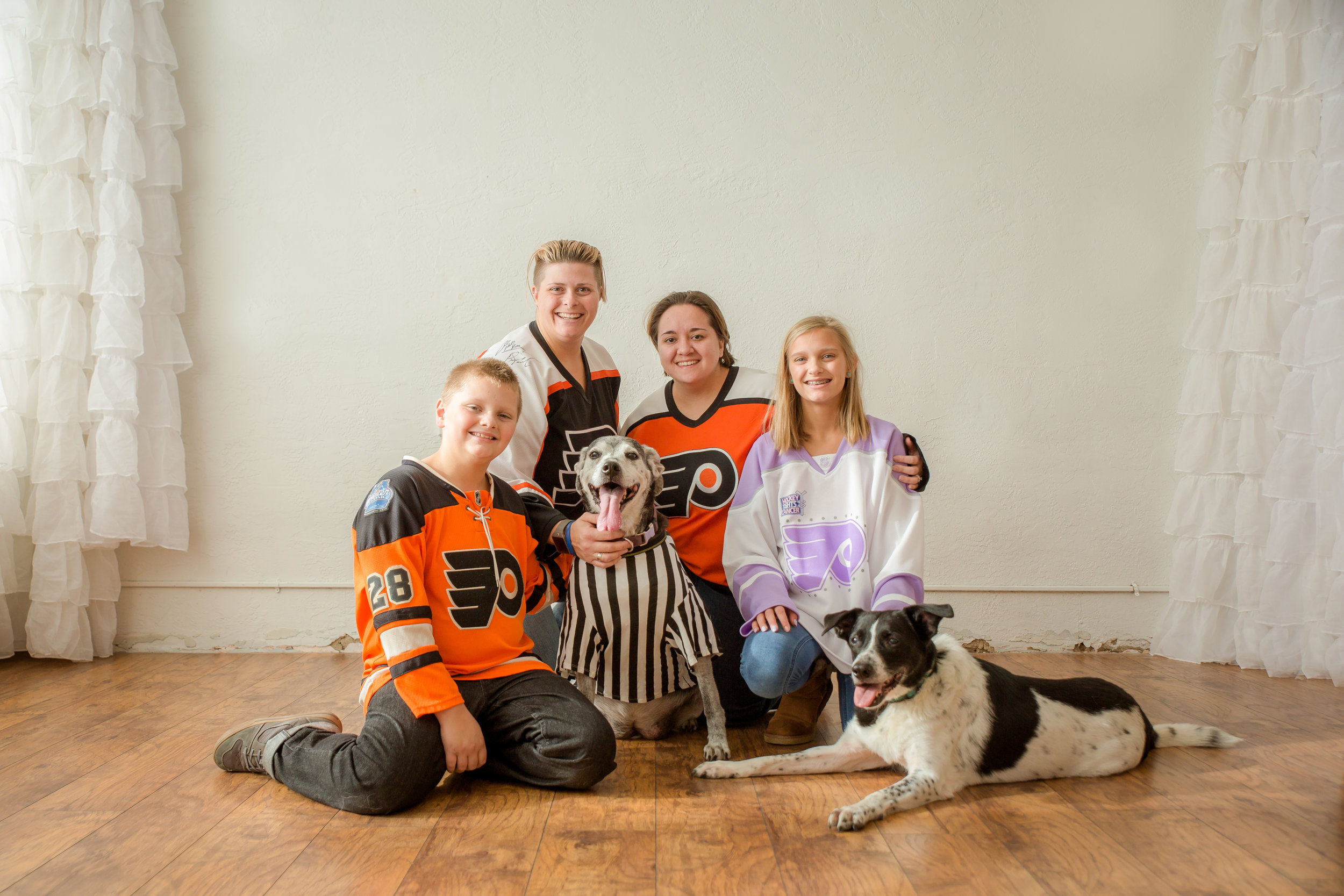 hockey lesbian family with two dogs