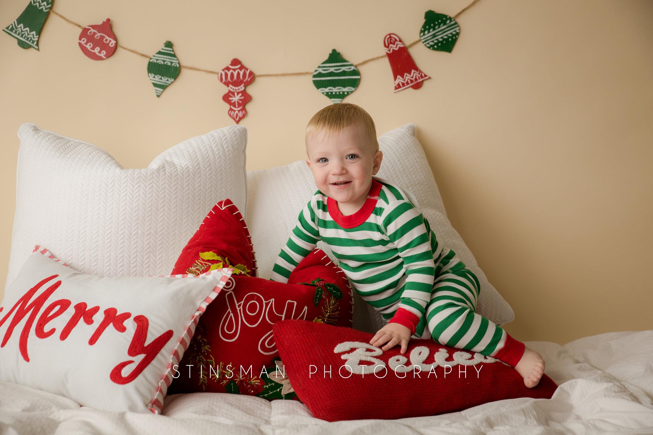 kid climbing through pillows