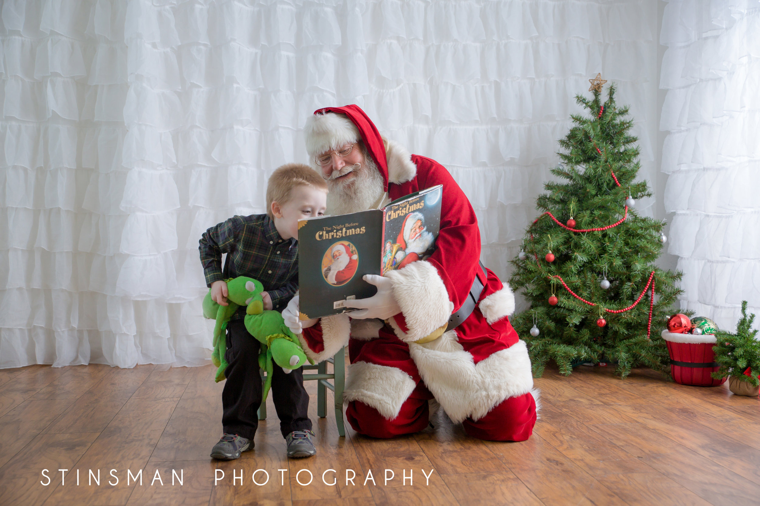 santa reading a book to a child with Autism