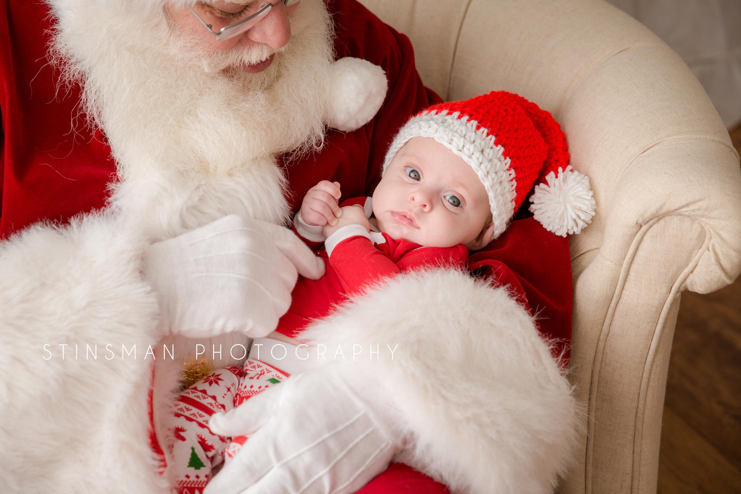 Santa holding a newborn baby girl