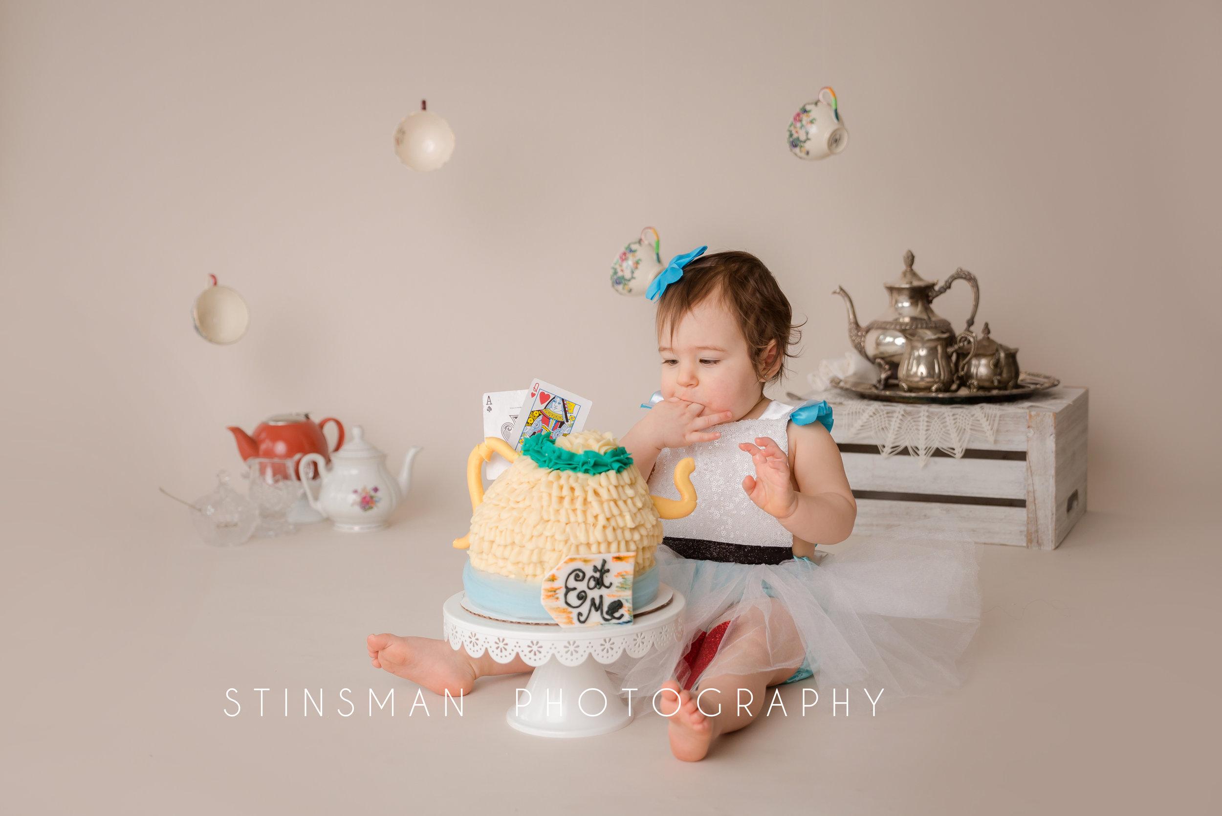 Aria eating her cake at her cake smash