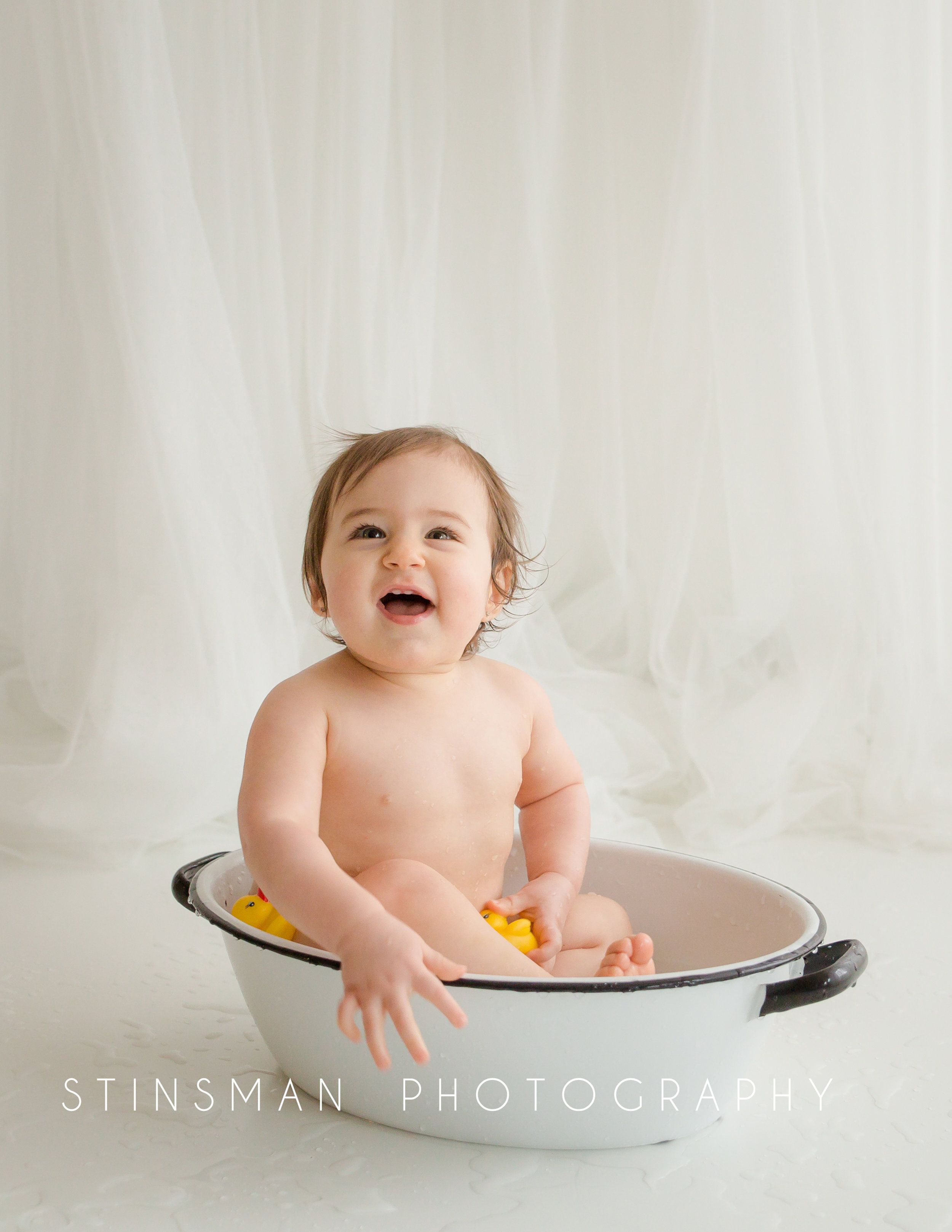 baby laughing and smiling