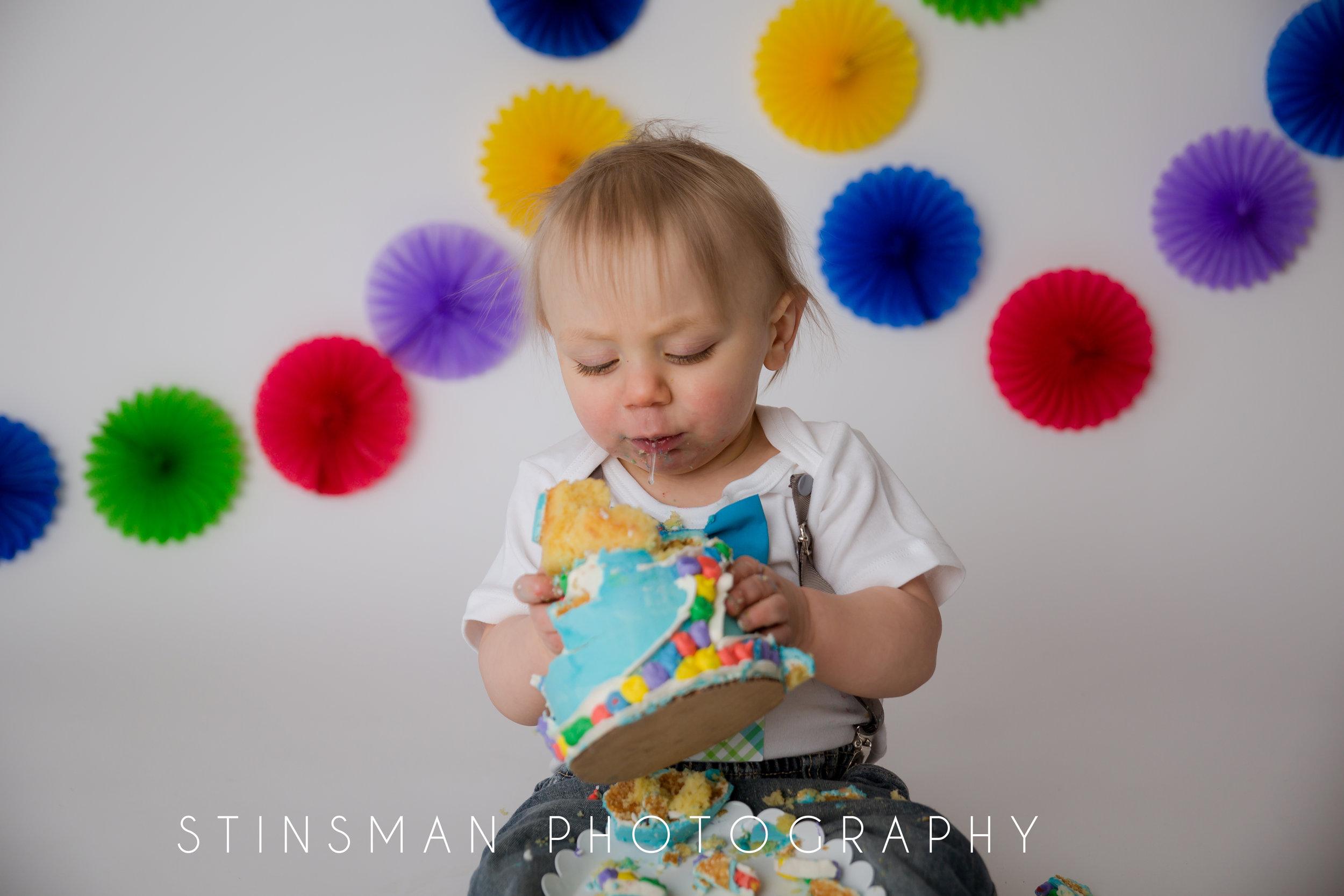 one year old boy smashing his cake everywhere