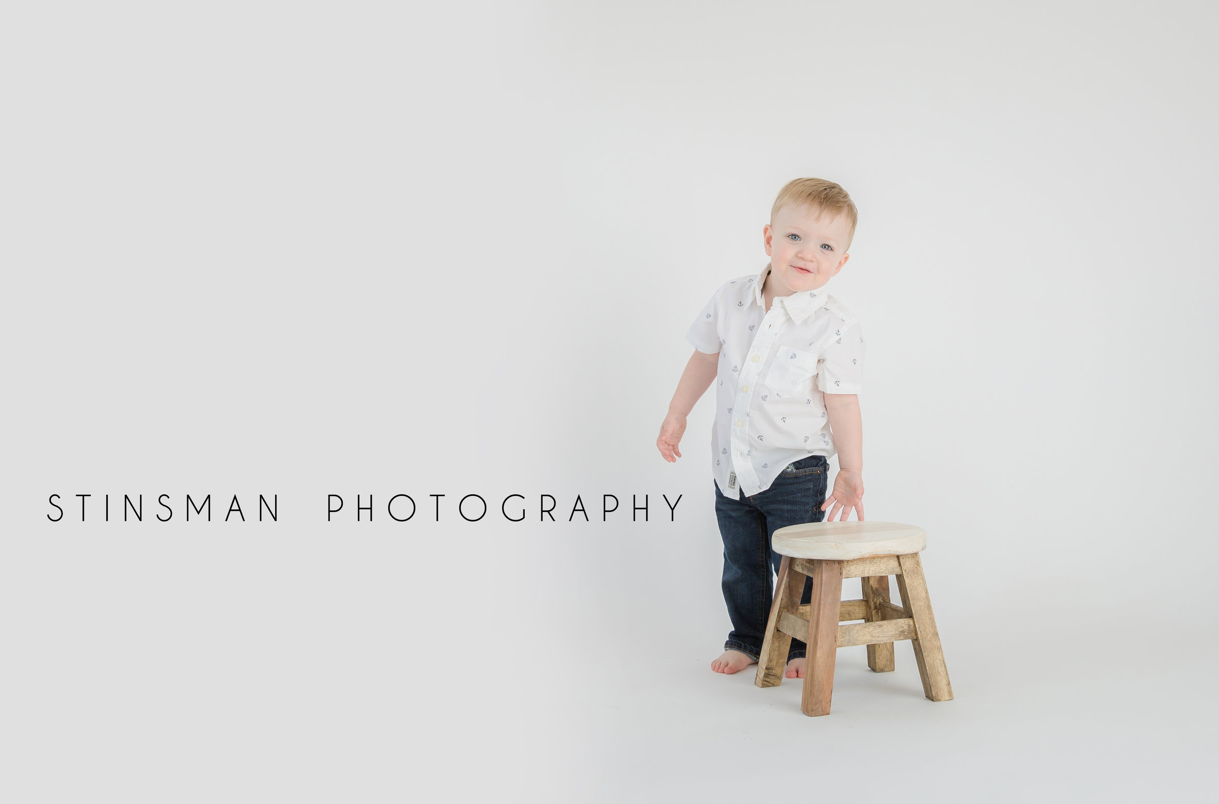 two year old boy with a stool wearing a white t shirt