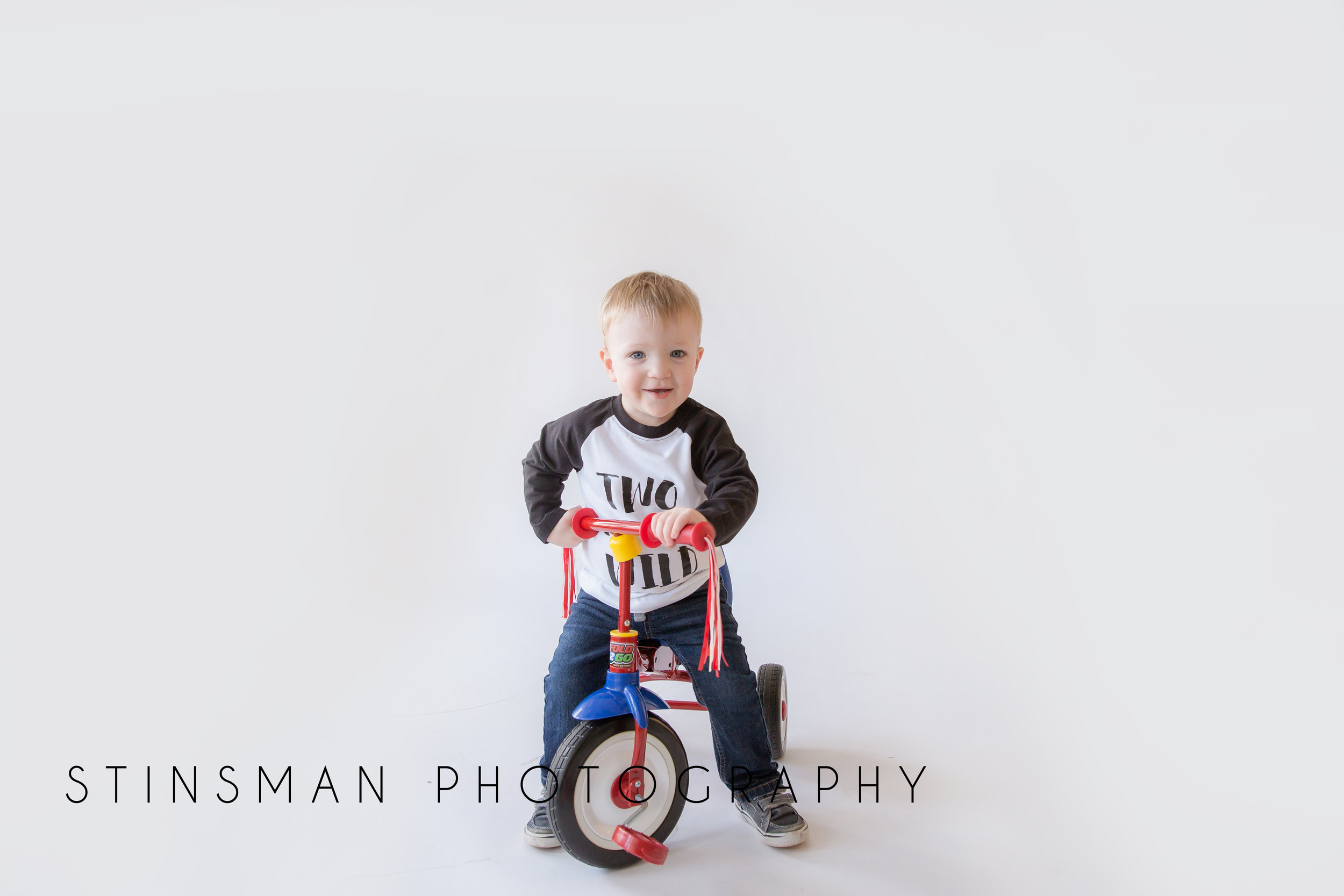 little boy on a tricycle