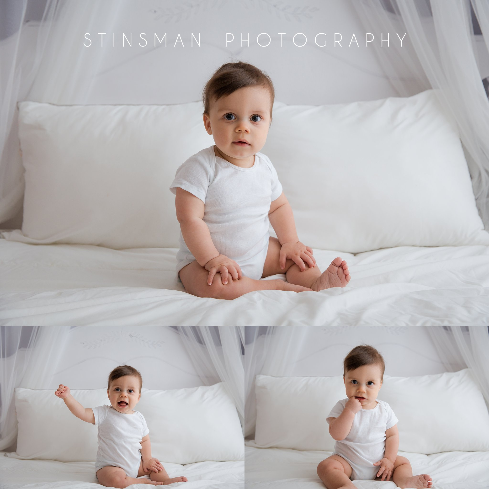 little boy sitting on a bed white white curtains