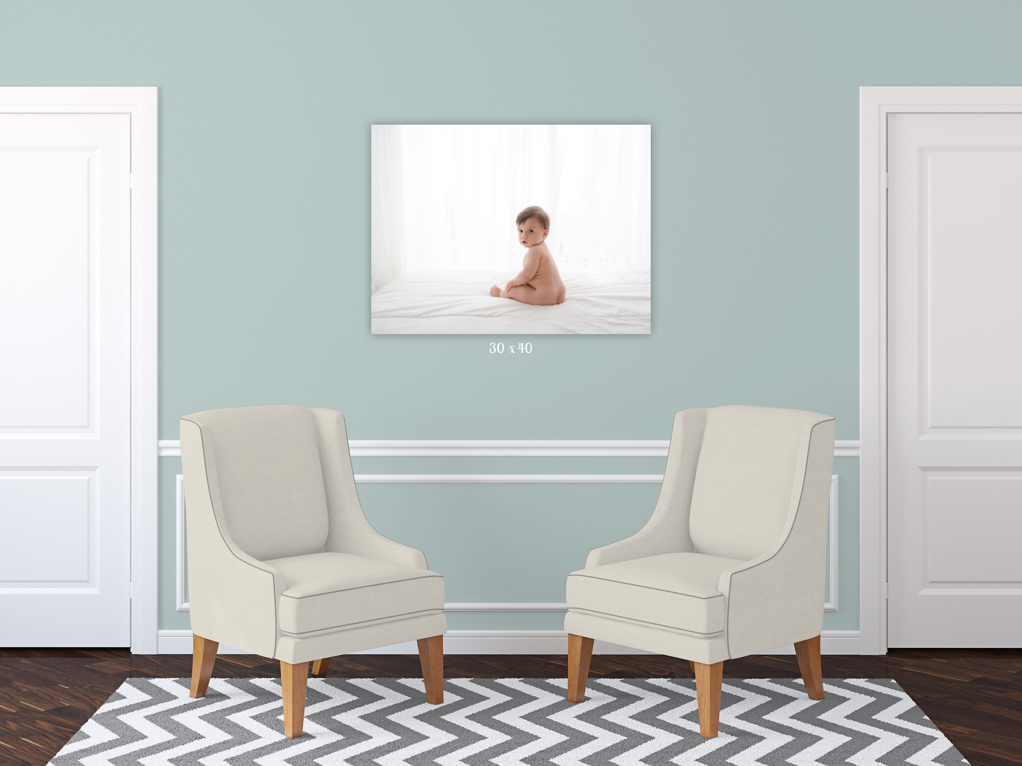 hallway wall gallery of a baby boy in white