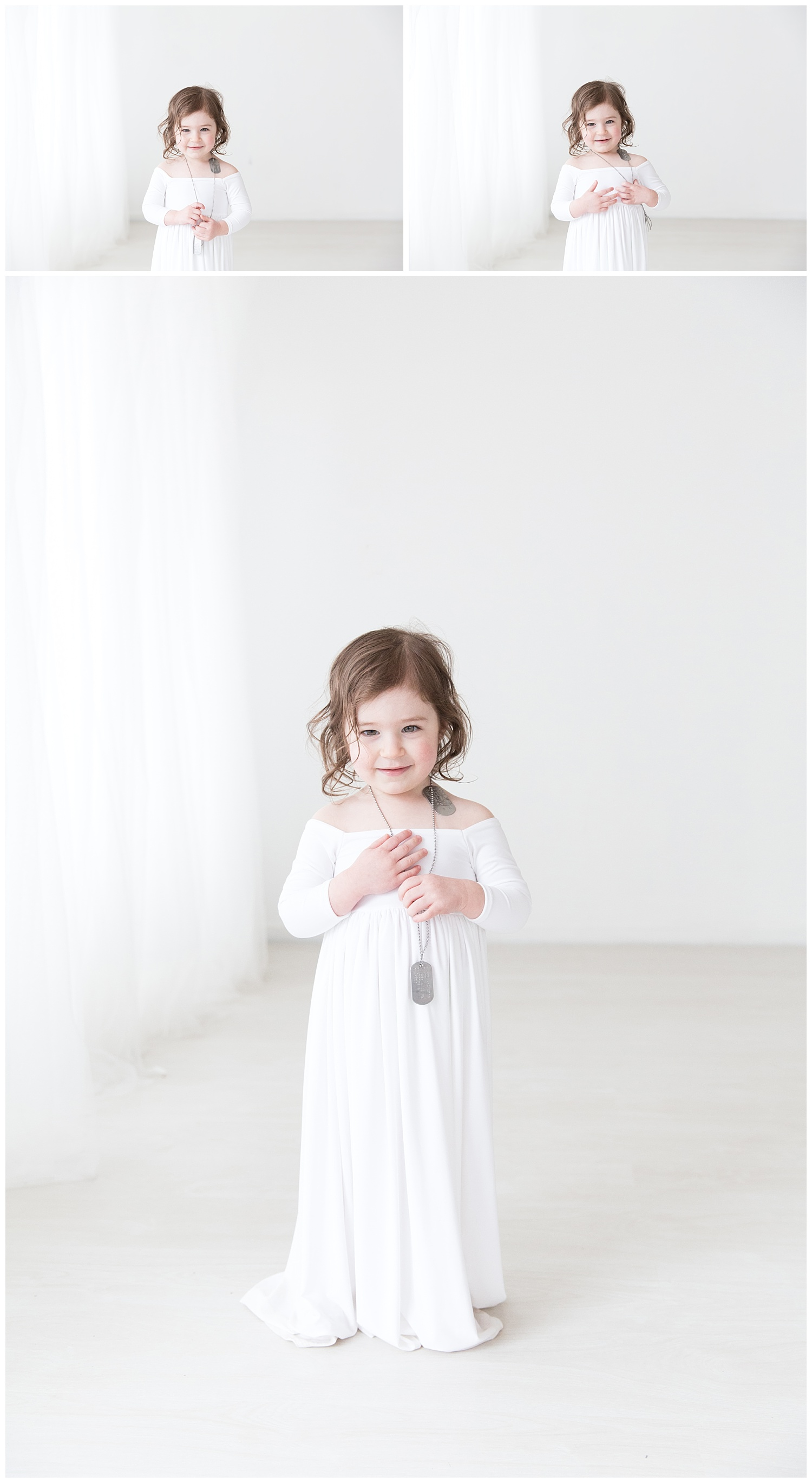 2 year old little girl wearing white and her dad's dog tags who is in the air force