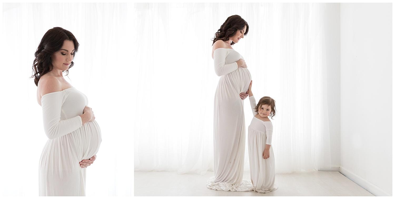 daughter holding moms pregnant belly in burlington nj