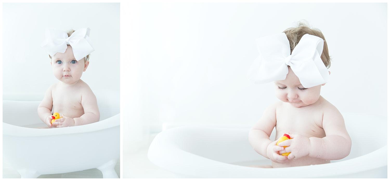 baby girl in the tub in burlington nj birthday photos