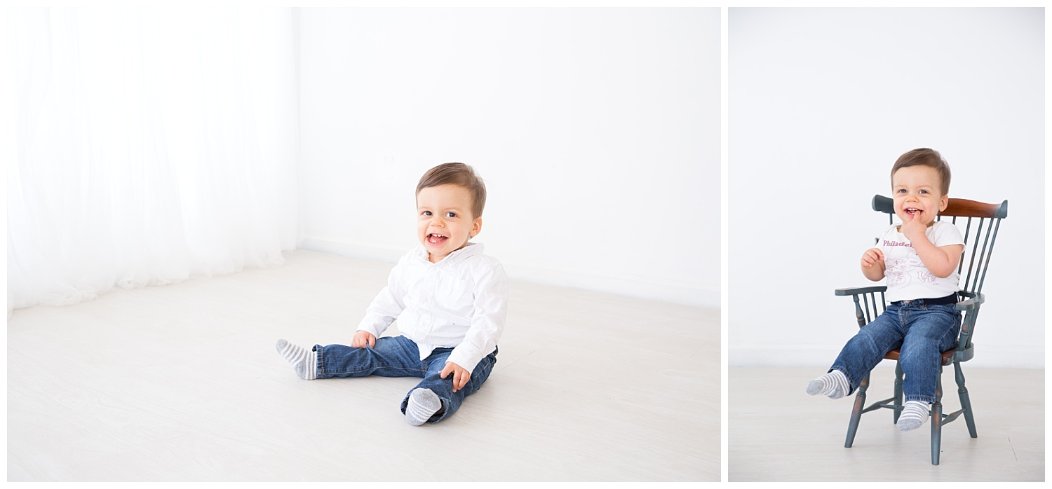 little boy wearing a white shirt sitting in a chair in burlington new jersey for his first birthday photos
