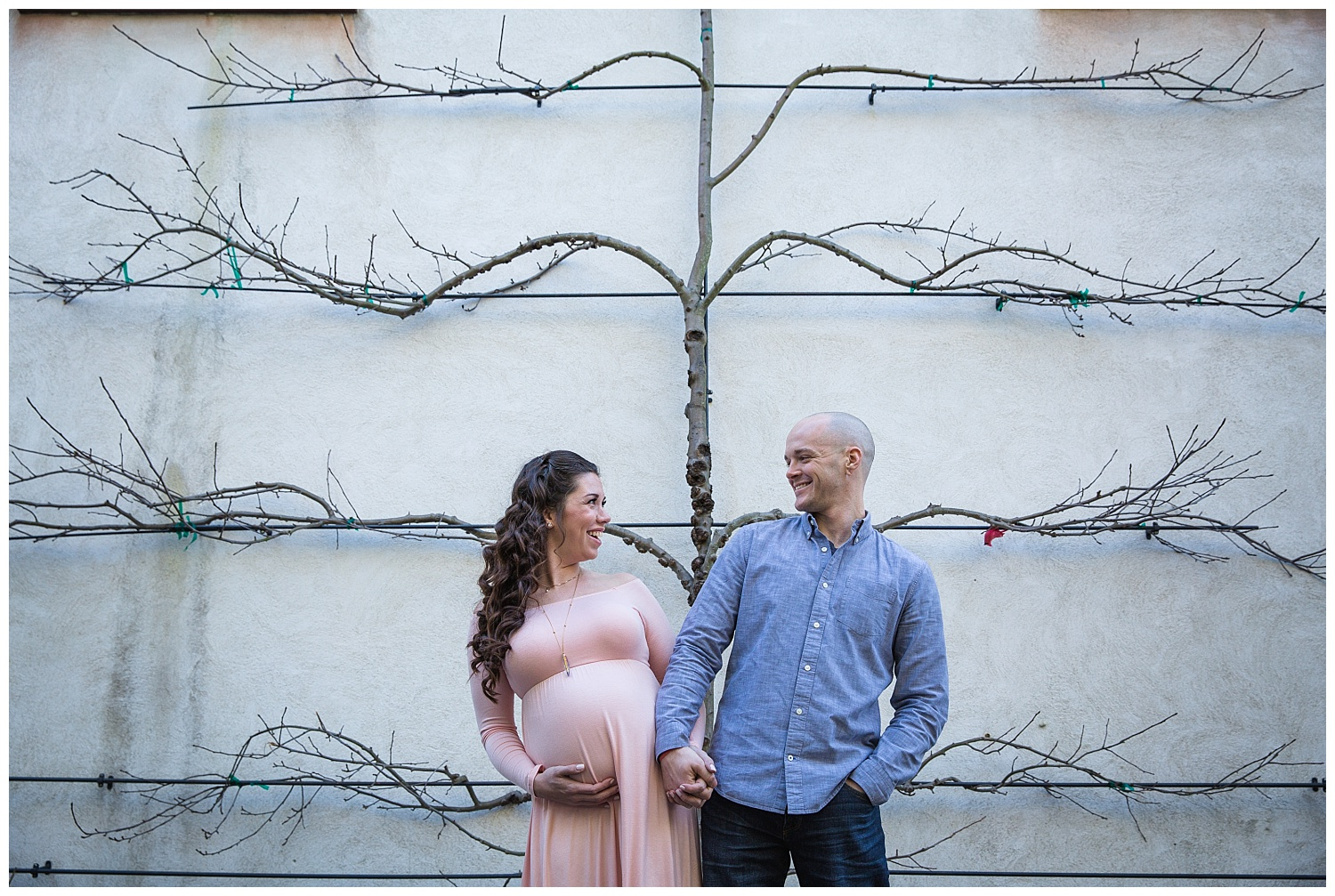 mom and dad looking and laughing at each other at smithville mansion maternity session